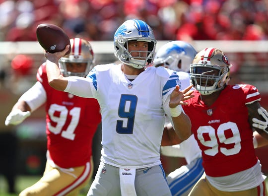 Matthew Stafford looks to throw as 49ers defensive end DeForest Buckner (99) applies pressure during the first half.