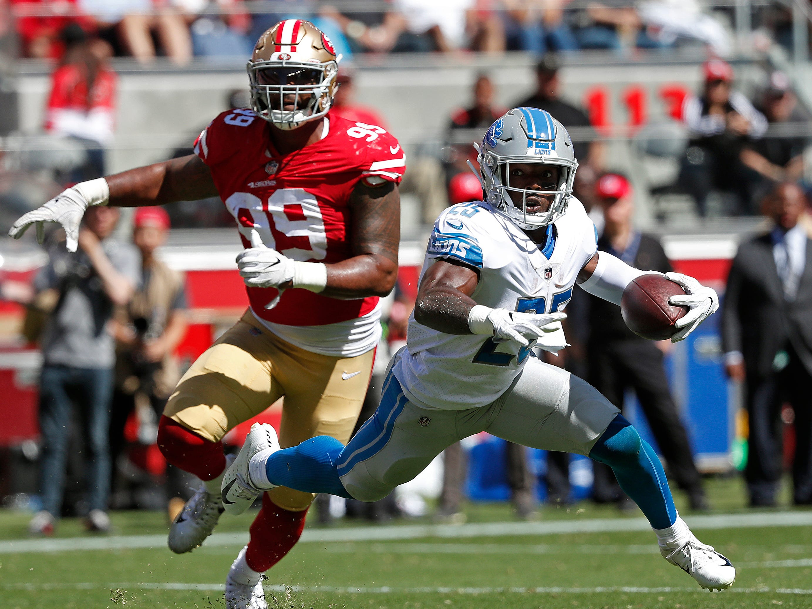 Lions running back Theo Riddick runs with the ball as 49ers defensive end DeForest Buckner (99) pursues during the first half on Sunday, Sept. 16, 2018, in Santa Clara, Calif.
