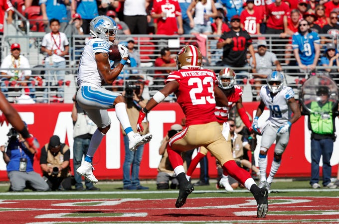 Detroit Lions receiver Marvin Jones Jr. catches a touchdown against San Francisco 49ers cornerback Ahkello Witherspoon in the fourth quarter in Santa Clara, Calif., Sunday, Sept. 16, 2018.