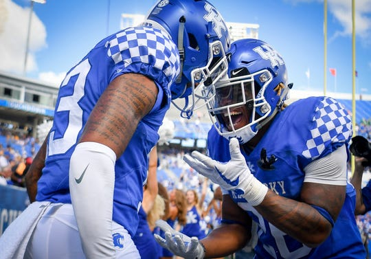 Week 3 of the college football season saw the biggest upsets, which turned into the most movement in the Free Press' football rankings this season. Dropping out is USC, Boise State and Florida State. Receiving votes are Kentucky (pictured), Boston College and BYU.