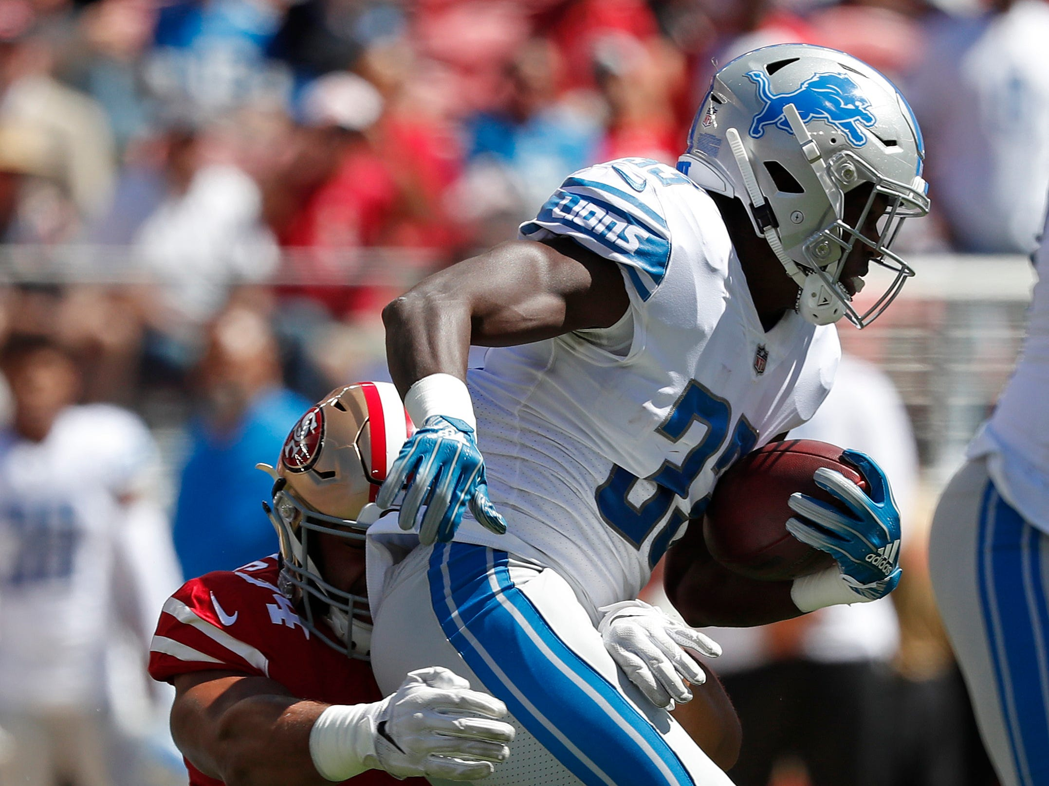 Lions running back Kerryon Johnson, right, runs with the ball against 49ers defensive end Solomon Thomas (94) during the first half on Sunday, Sept. 16, 2018, in Santa Clara, Calif.