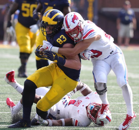Zach Gentry is tackled by SMU defenders during the first half.
