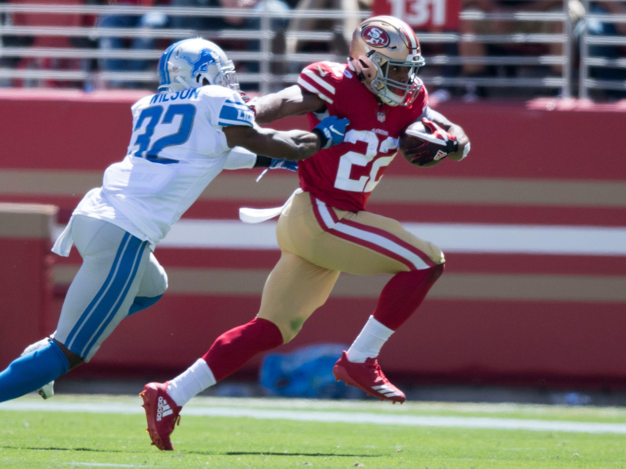 49ers running back Matt Breida is tackled by Lions defensive back Tavon Wilson during the first quarter Sunday, Sept. 16, 2018, in Santa Clara, Calif.
