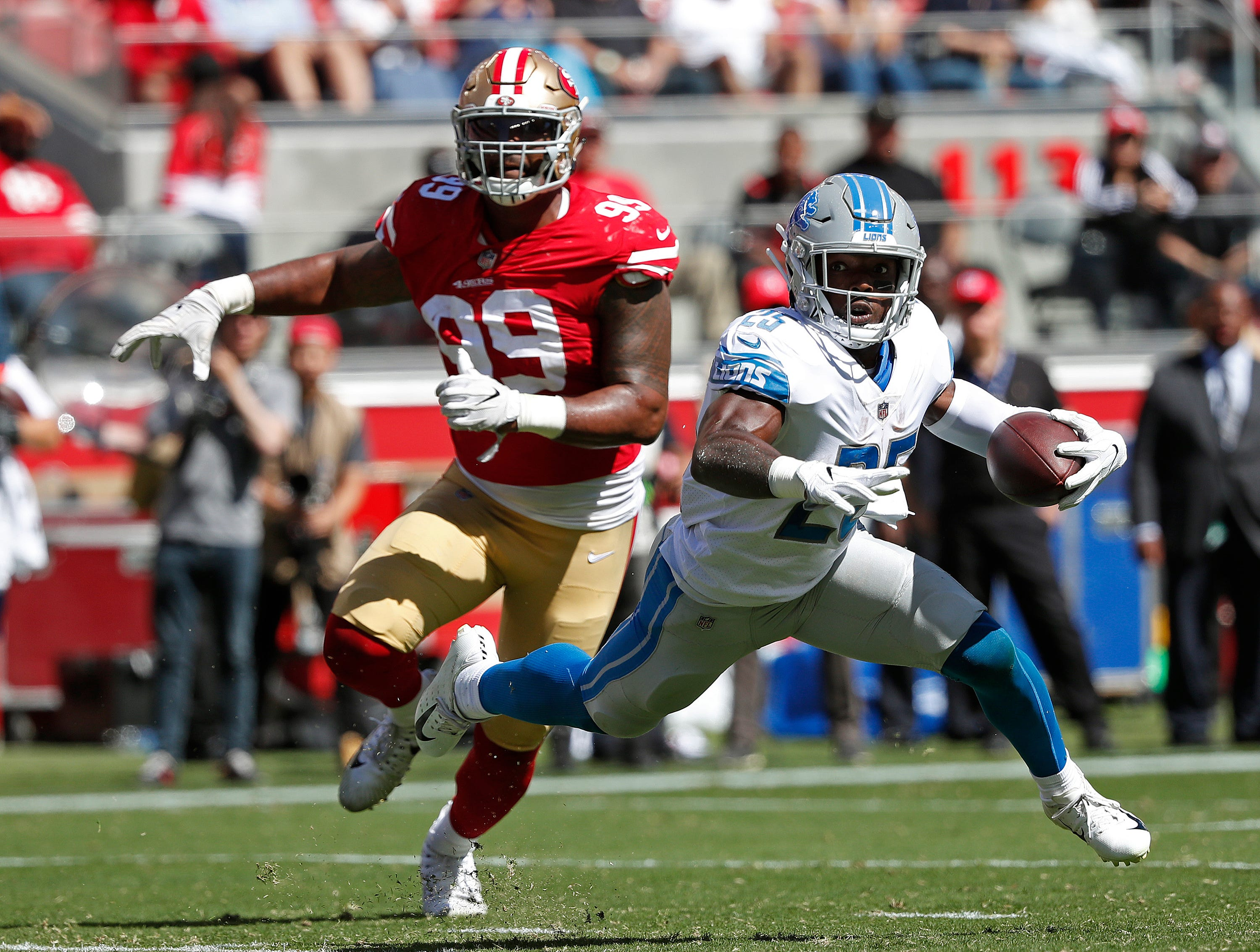 Detroit Lions running back Theo Riddick runs with the ball as San Francisco 49ers defensive end DeForest Buckner (99) pursues during the first half of an NFL football game in Santa Clara, Calif., Sunday, Sept. 16, 2018. (AP Photo/Tony Avelar)