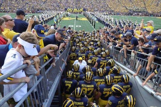 Michigan Stadium tunnel, Michigan fans, Go Blue flag