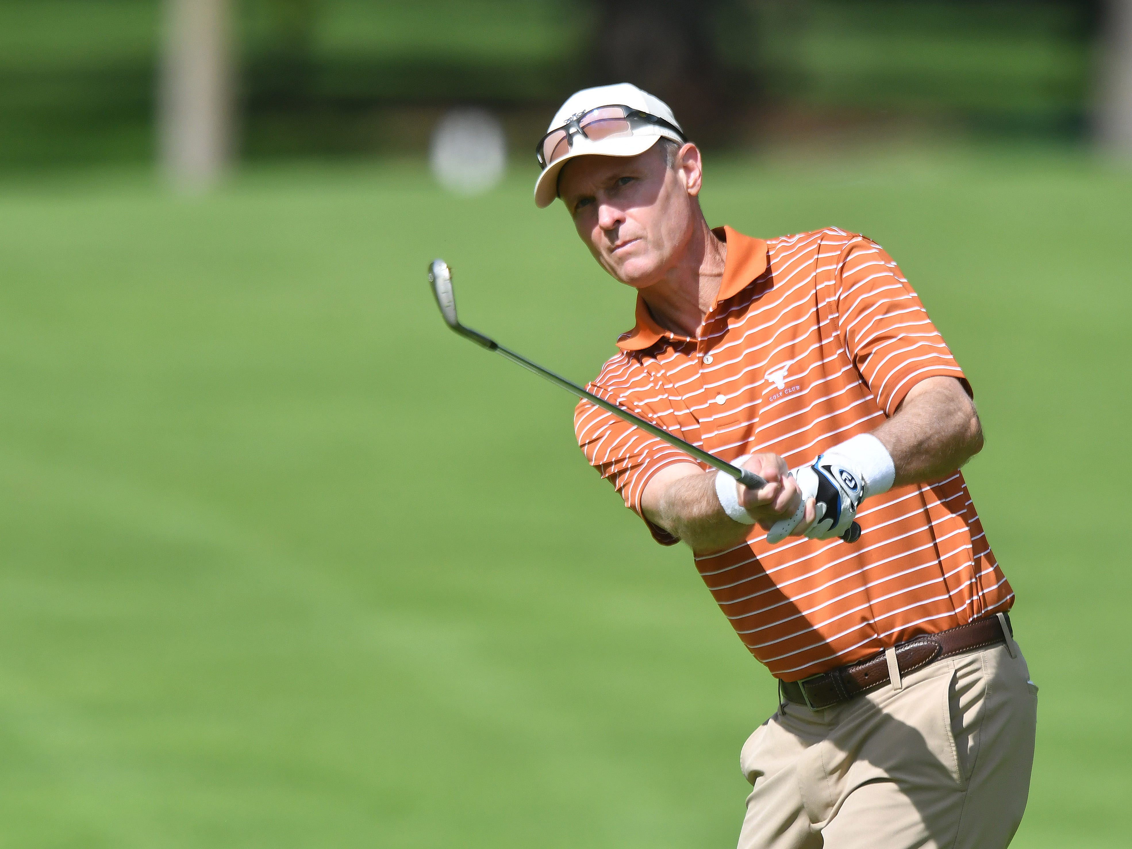 Bob Estes watches his approach shot on the first hole at the Ally Challenge.
