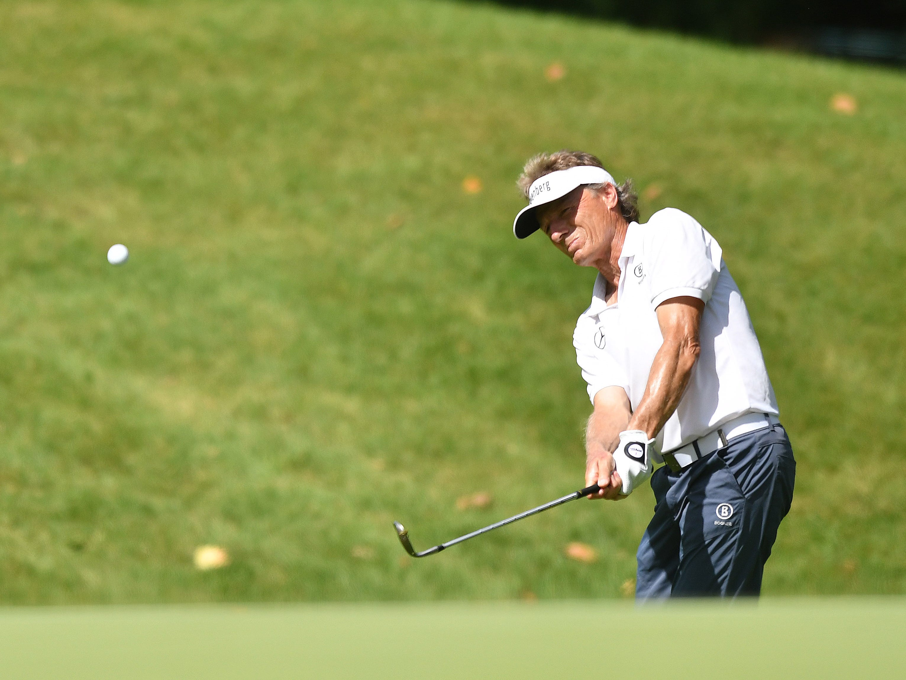 Bernard Langer watches his chip shot on the first hole at the Ally Challenge.