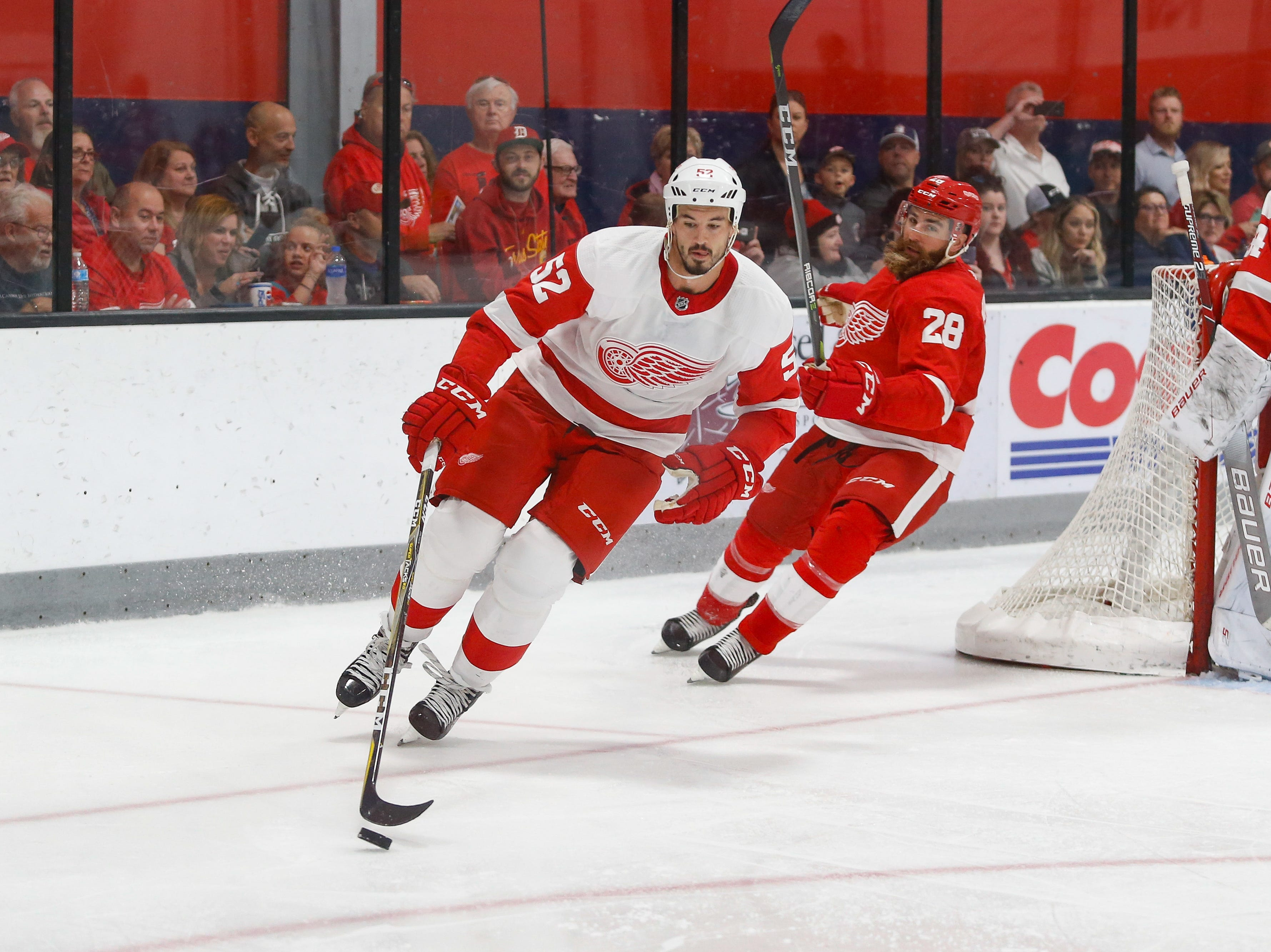 Jonathan Ericsson wheels behind the net with the puck and with Luke Witkowski giving chase.