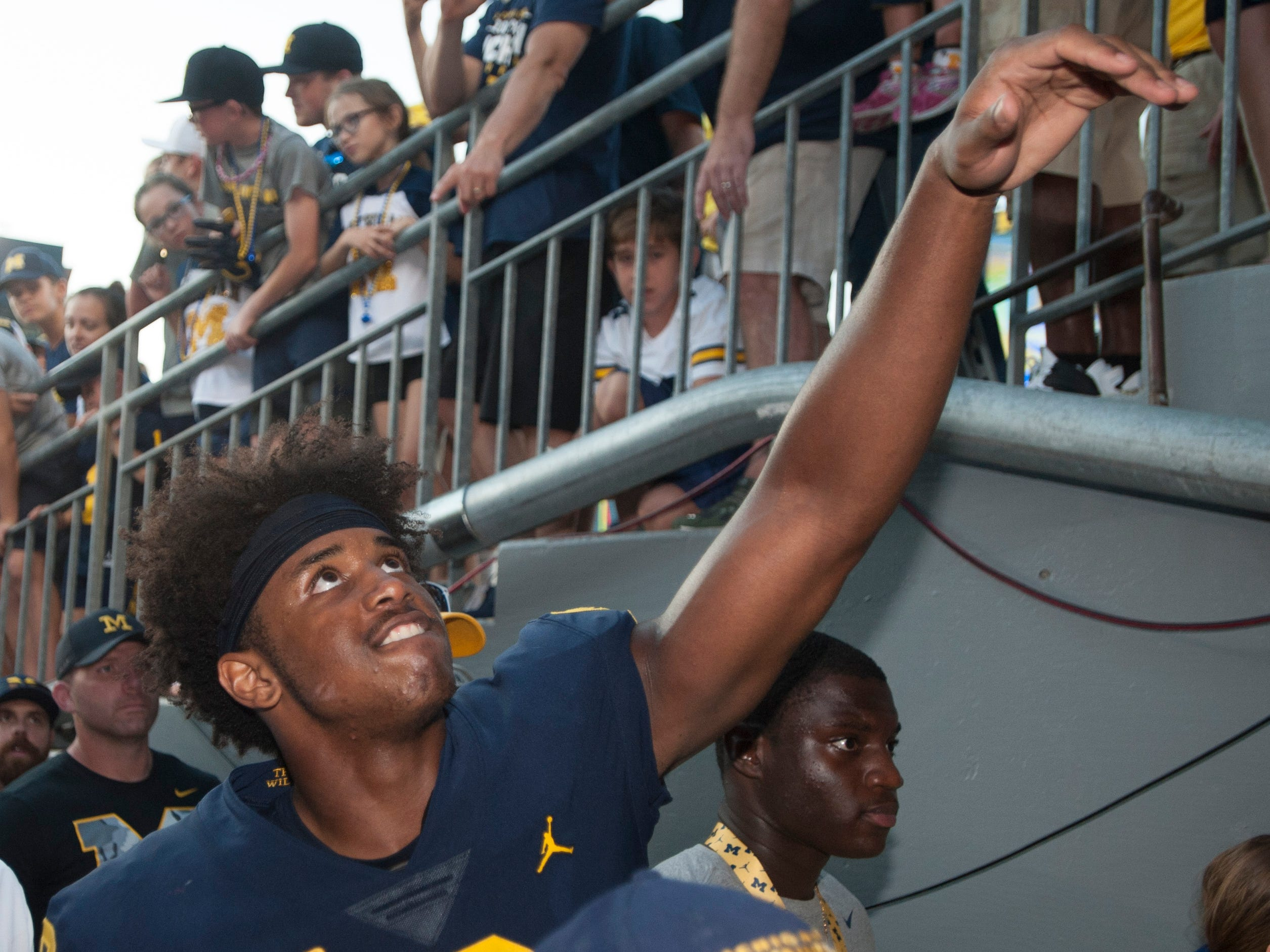 Michigan wide receiver Donovan Peoples-Jones tosses his gloves to fans as he heads up the Michigan Stadium tunnel to the locker room after the game. DPJ caught four passes for 90 yards and three touchdowns in the game.