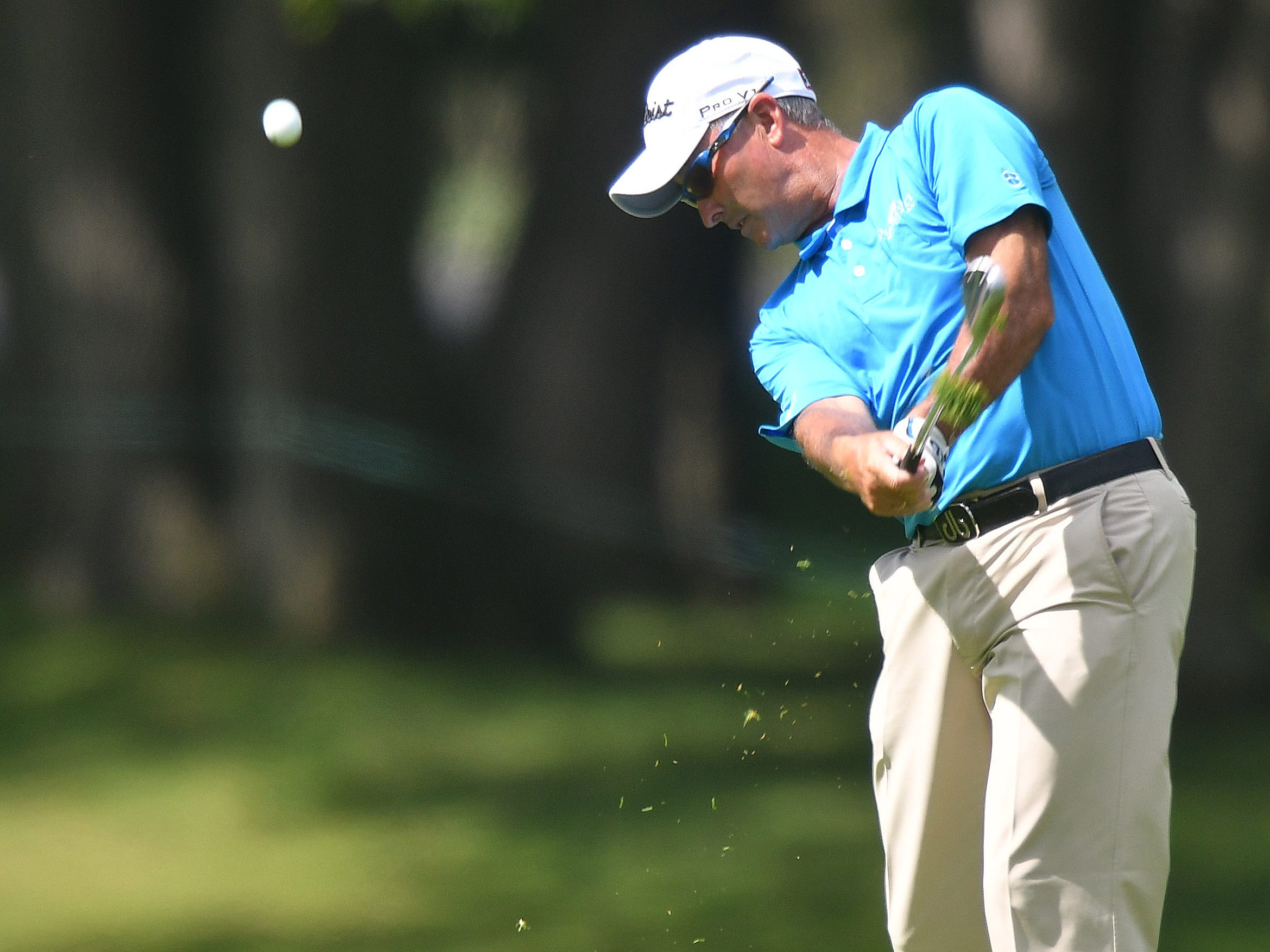 David McKenzie hits at the first green from the fairway at the Ally Challenge.