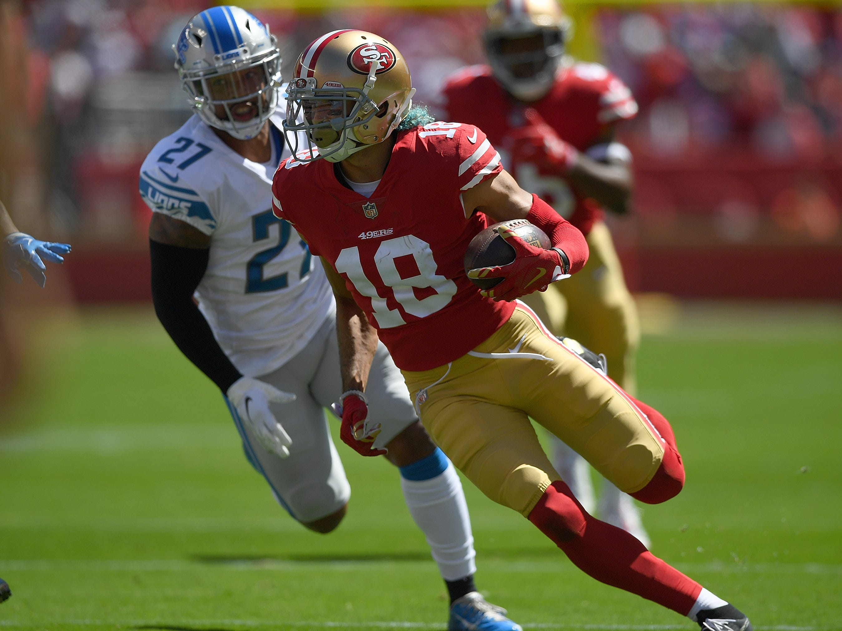 49ers' Dante Pettis catches a pass and runs for a first down against the Detroit Lions during the first quarter.