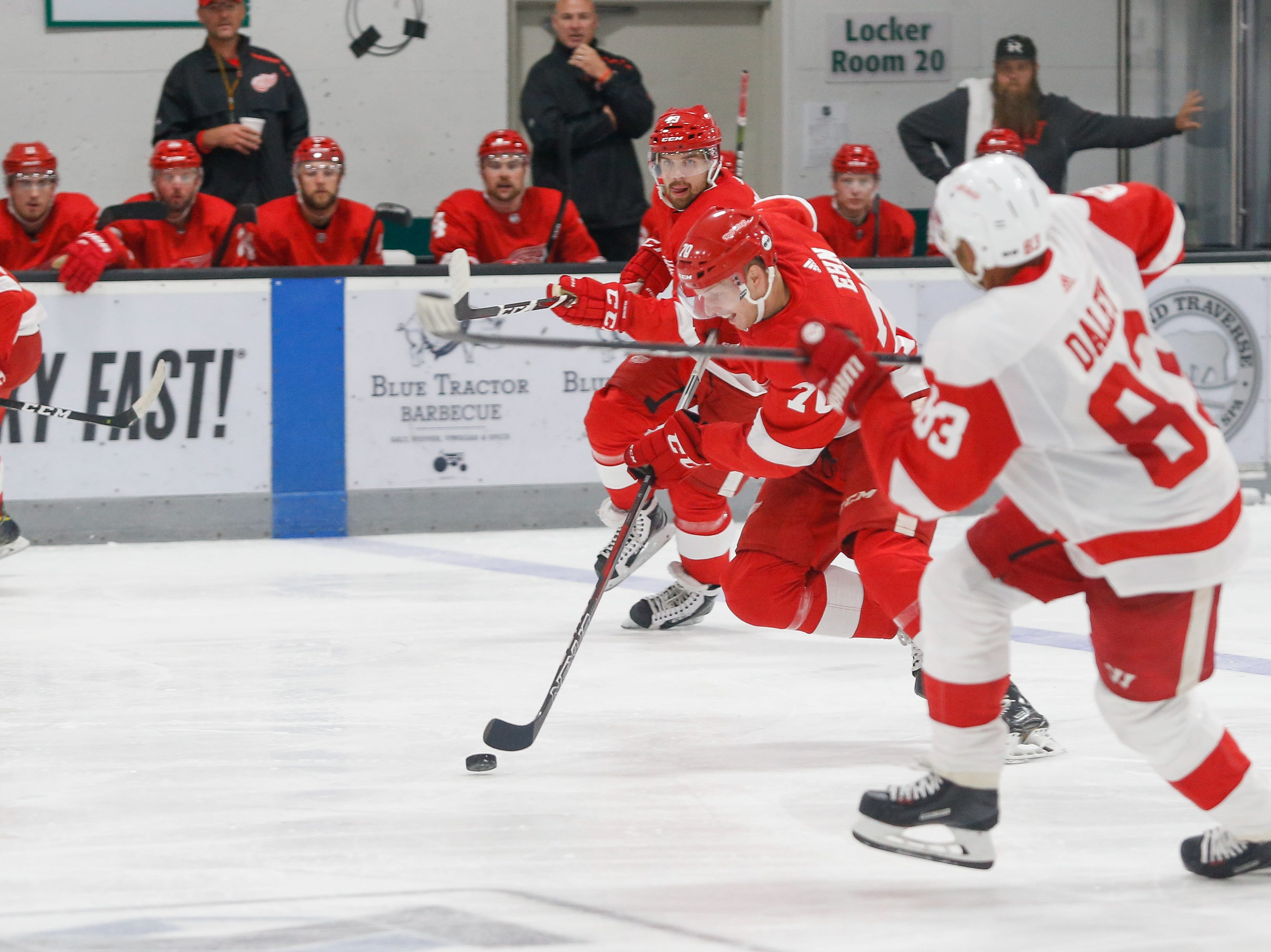 Christoffer Ehn (70) pushes the puck out of the Red zone as teammate Axel Holmstrom (49) trails and Trevor Dale (83) defends.
