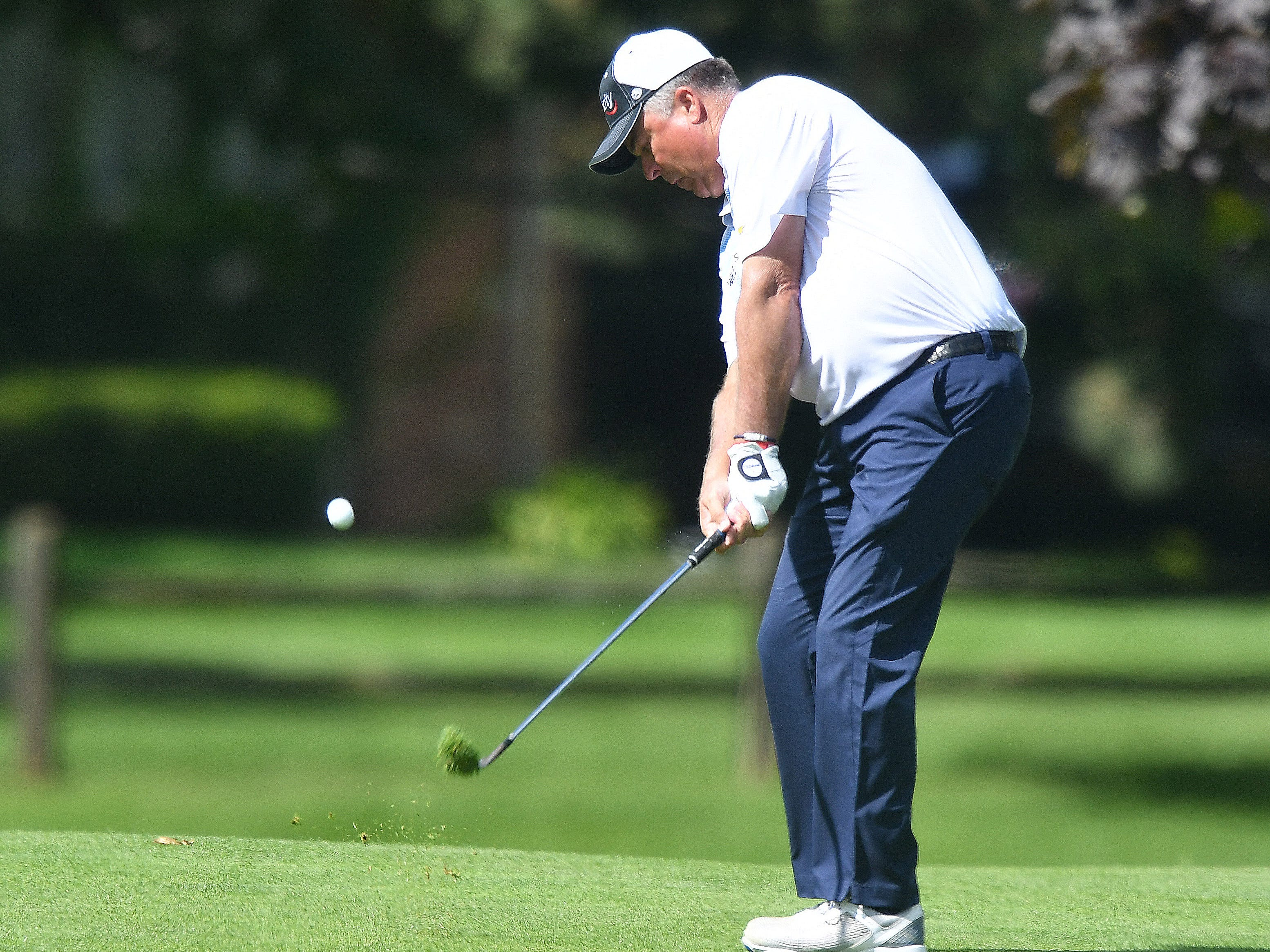 Kenny Perry hits an approach shot on the first hole at the Ally Challenge.