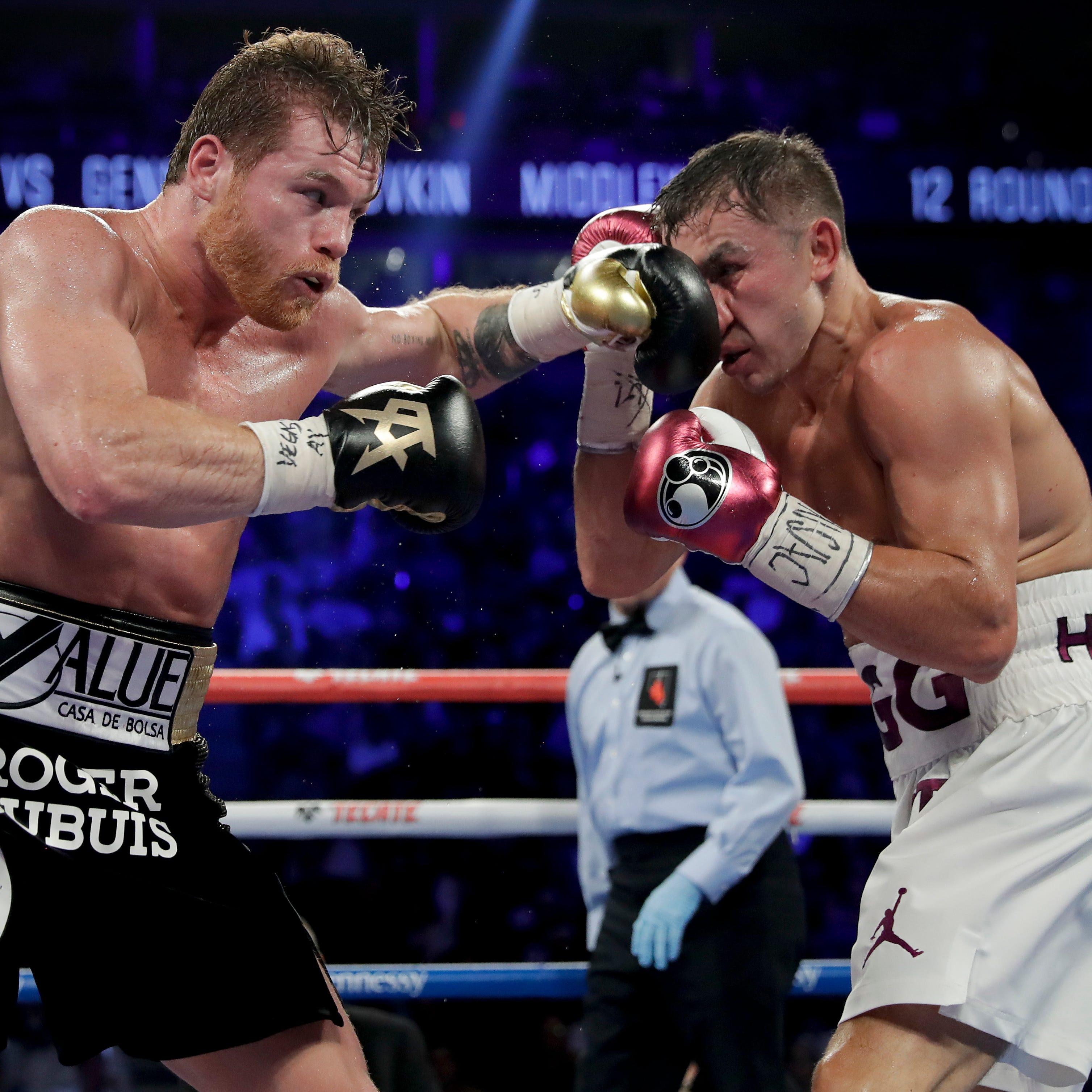 Alvarez hands Golovkin first pro loss in narrow decision
