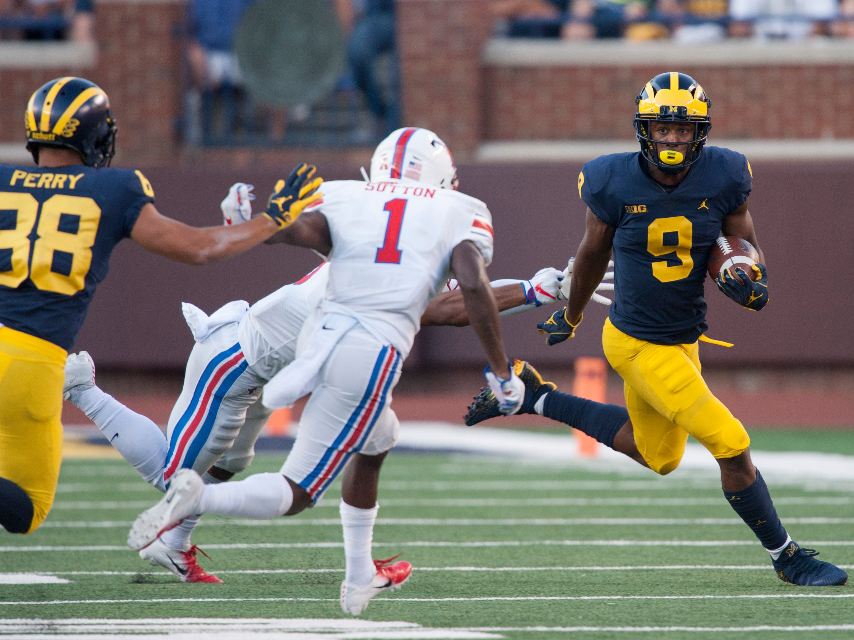 Michigan wide receiver Donovan Peoples-Jones gains some yardage on a sweep play in the second half. DPJ caught four passes for 90 yards and three touchdowns in the game as the Wolverines defeated the Southern Methodist University Mustangs 45-20 at Michigan Stadium in Ann Arbor on Saturday, September 15, 2018.