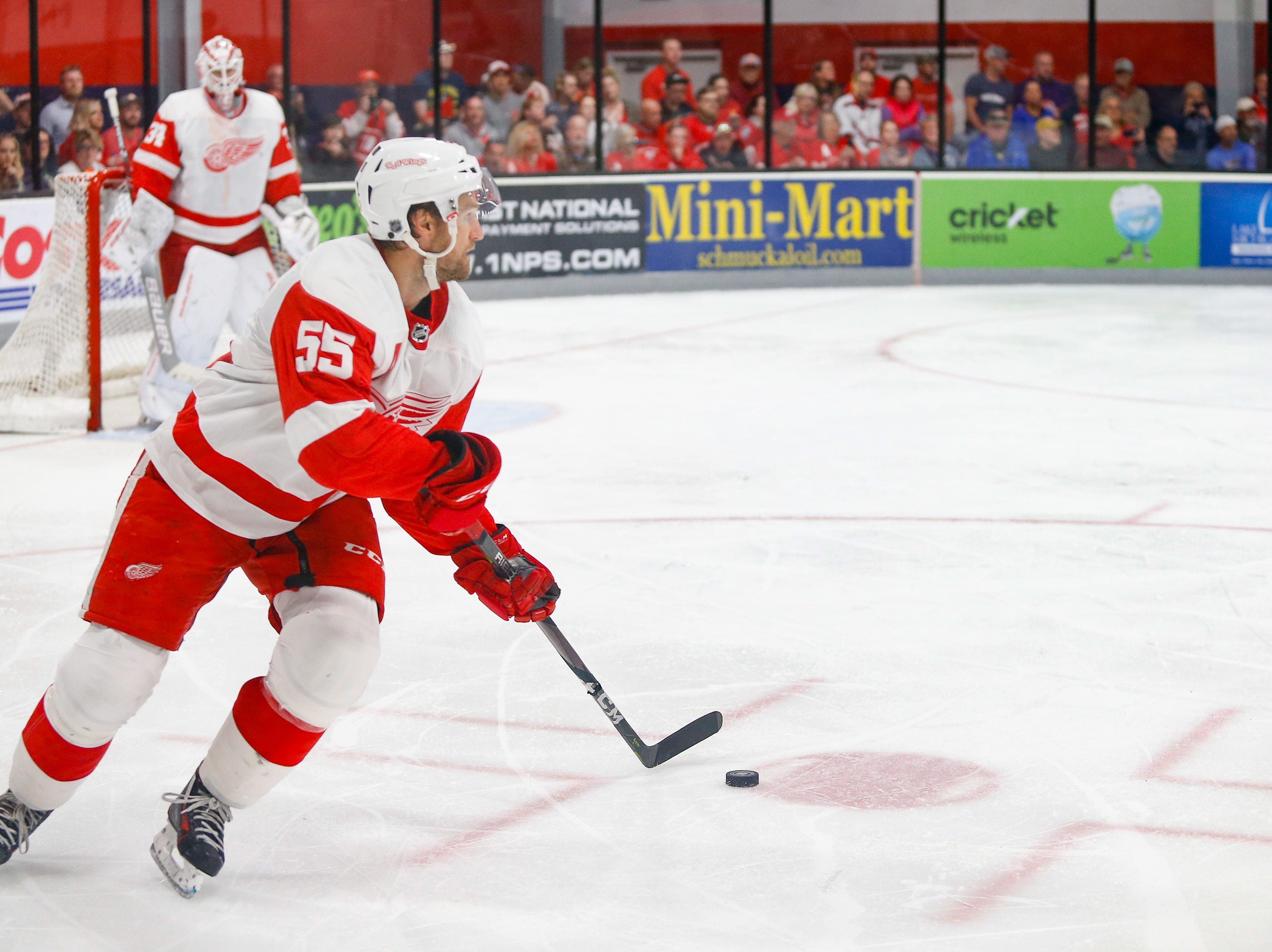 Niklas Kronwall turns and carries the puck out of the Team White end.