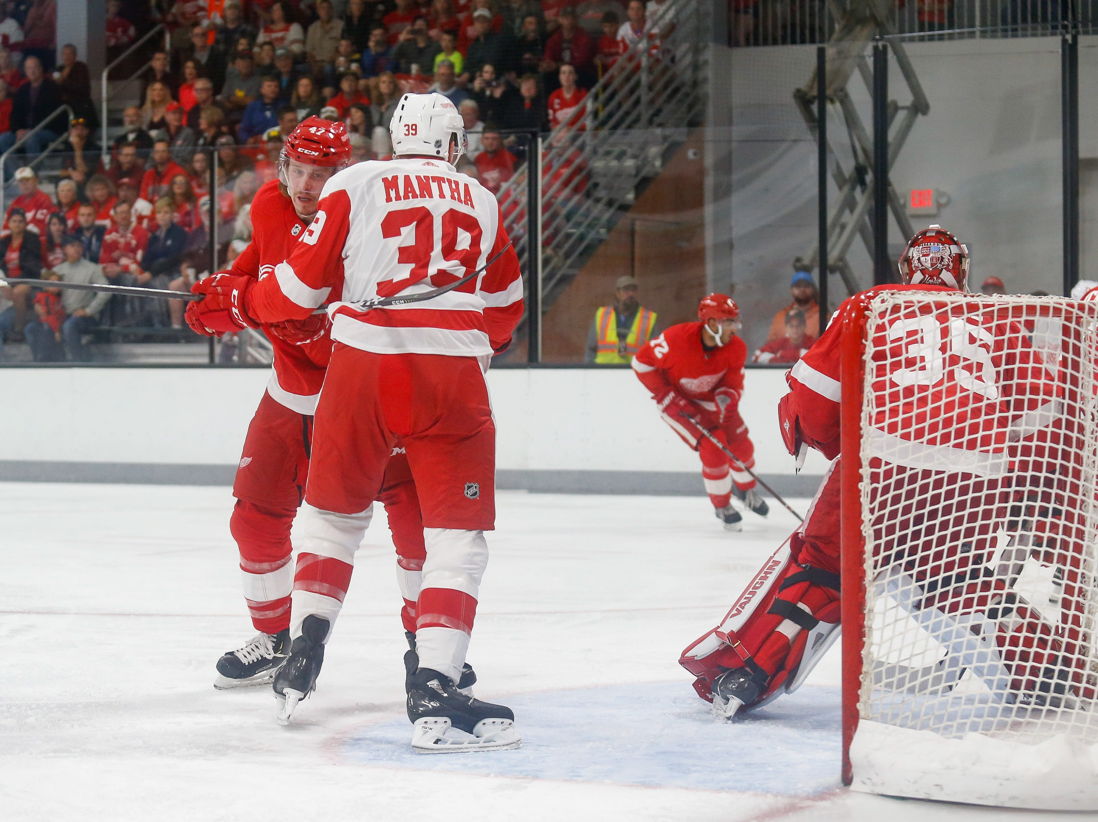Anthony Mantha (39) tries to maintain position in front of the net as defenseman Libor Sulak (47) tries to move him out.