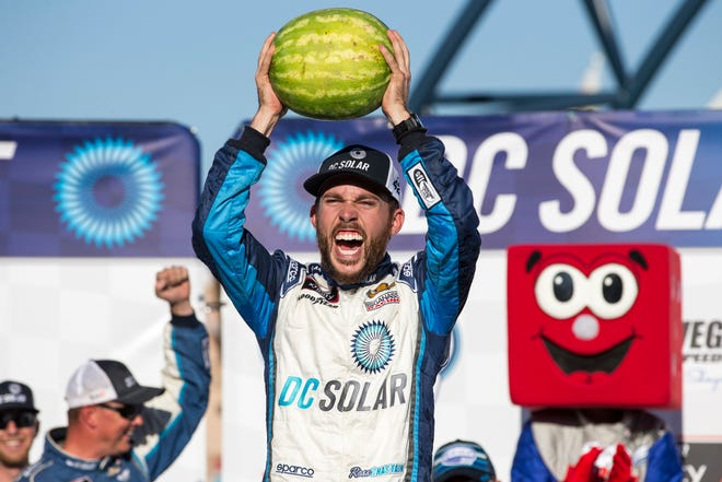 Ross Chastain celebrates in Victory Lane after winning the DC Solar 300 NASCAR Xfinity Series race at Las Vegas Motor Speedway on Saturday.