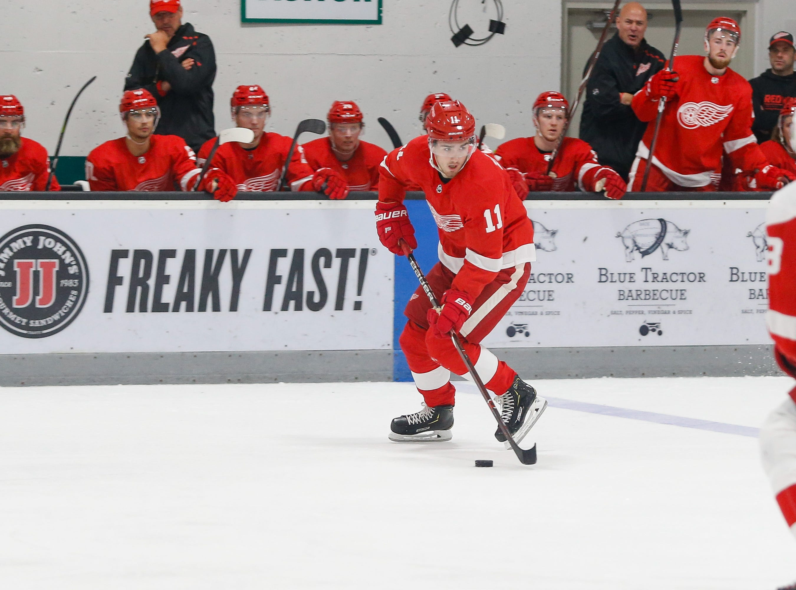 Filip Zadina looks for a passing lane as he carries the puck.