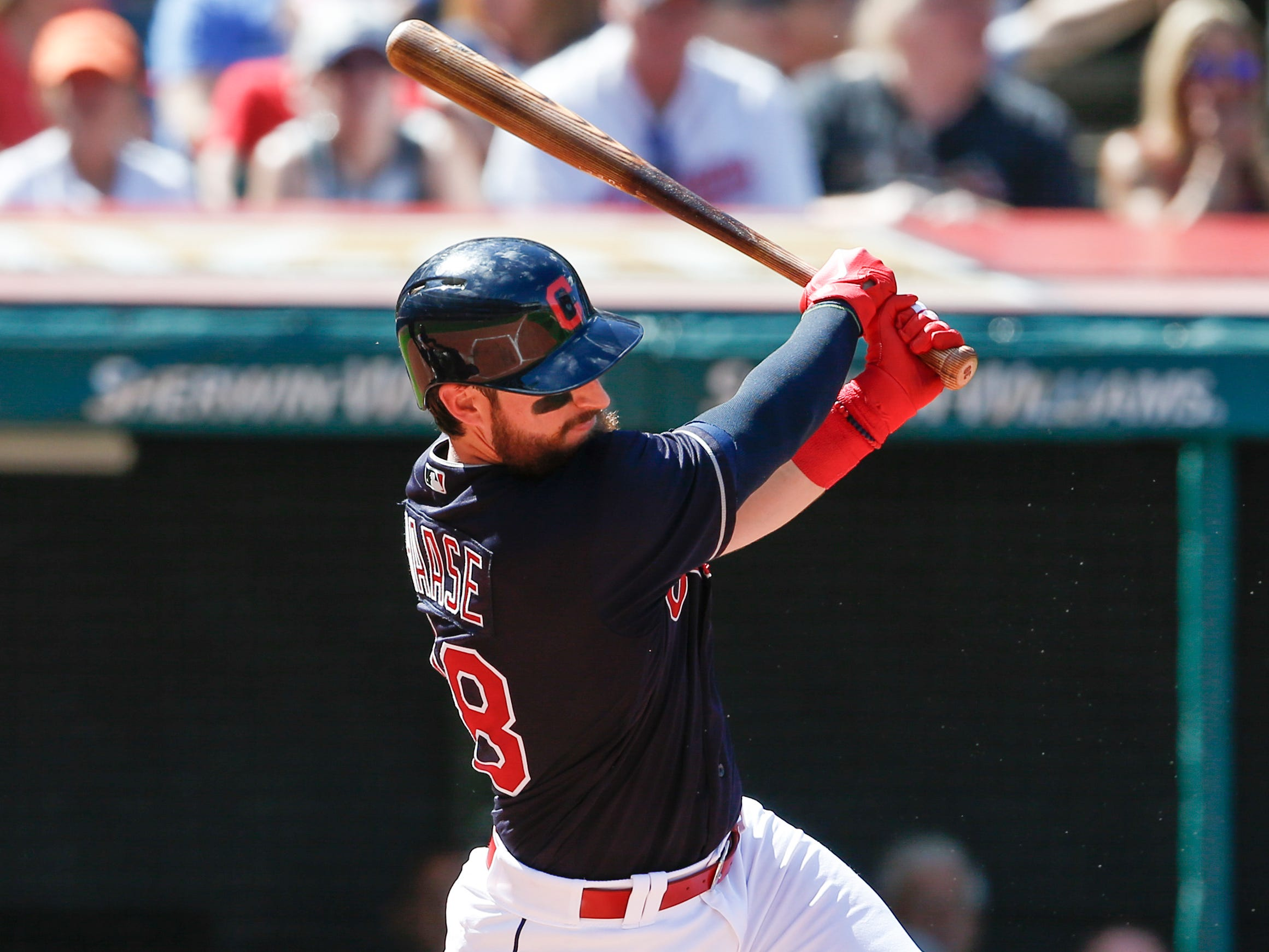 Cleveland Indians' Eric Haase hits an RBI single off Detroit Tigers starting pitcher Francisco Liriano during the fourth inning.