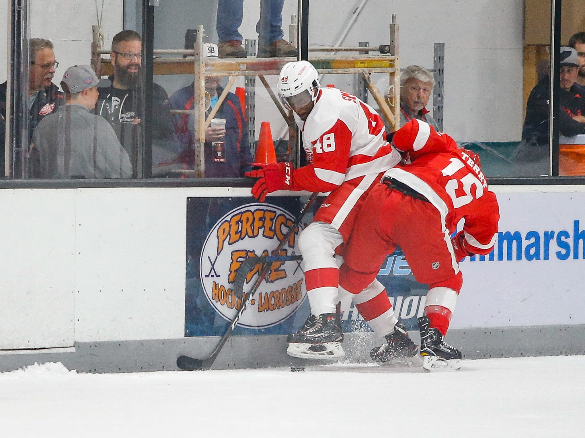 Givani Smith (48) and Chris Terry (15) fight for a puck in the first period.