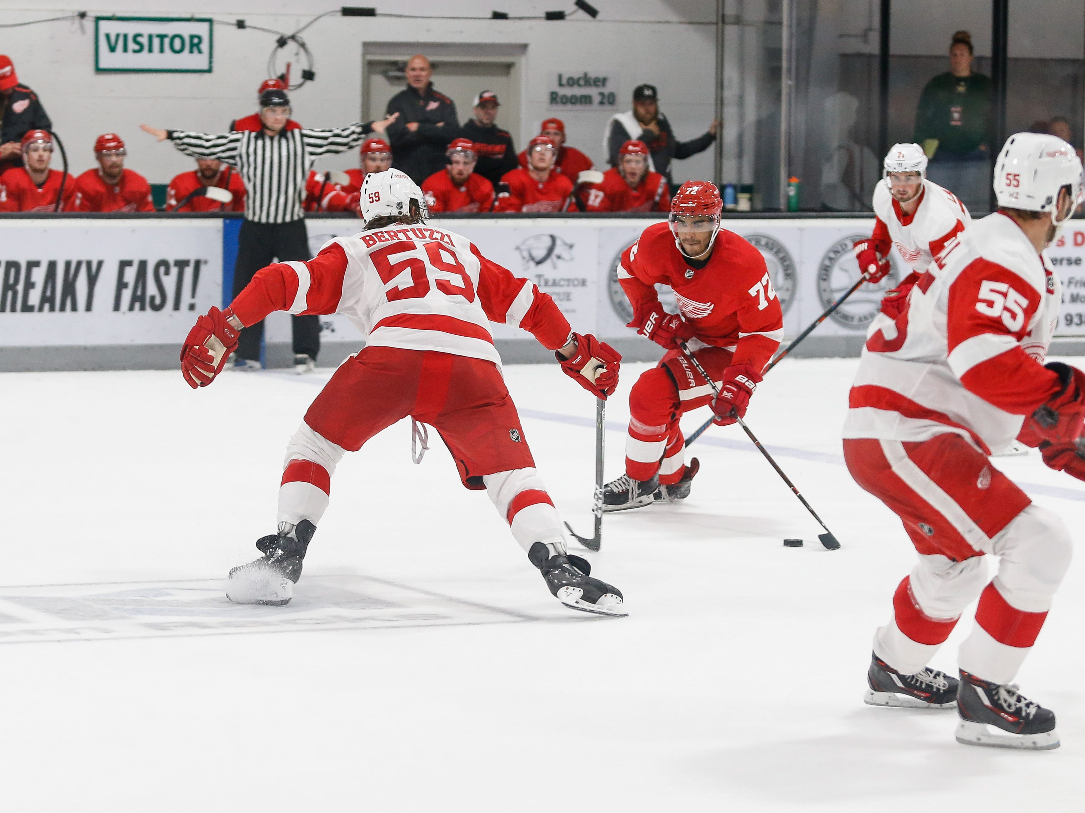 Tyler Bertuzzi tries to prevent Andreas Athanasiou from moving in on Team White's net.