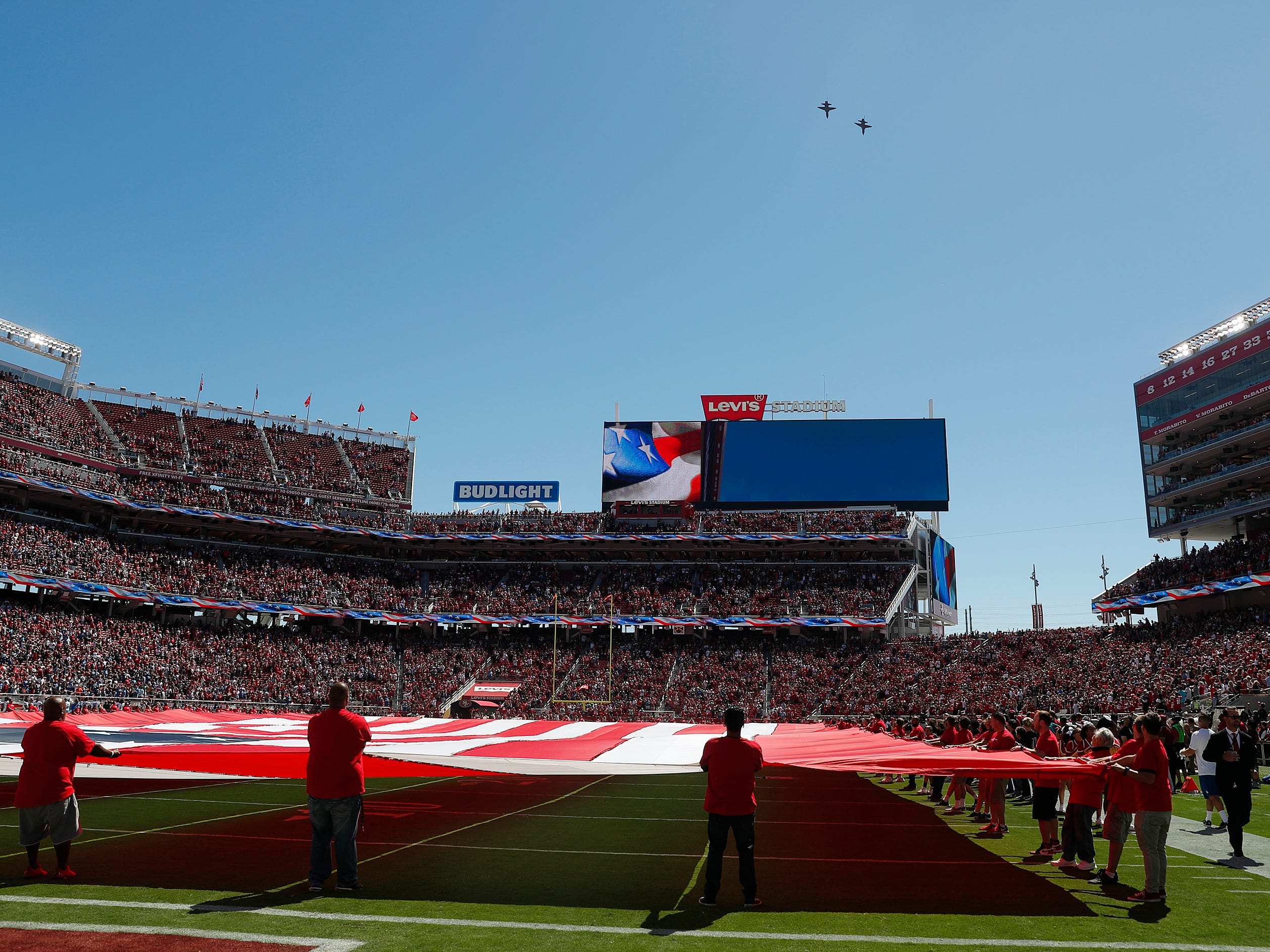 A pair of jets do a flyover above Levi's Stadium before the start of an NFL football game.