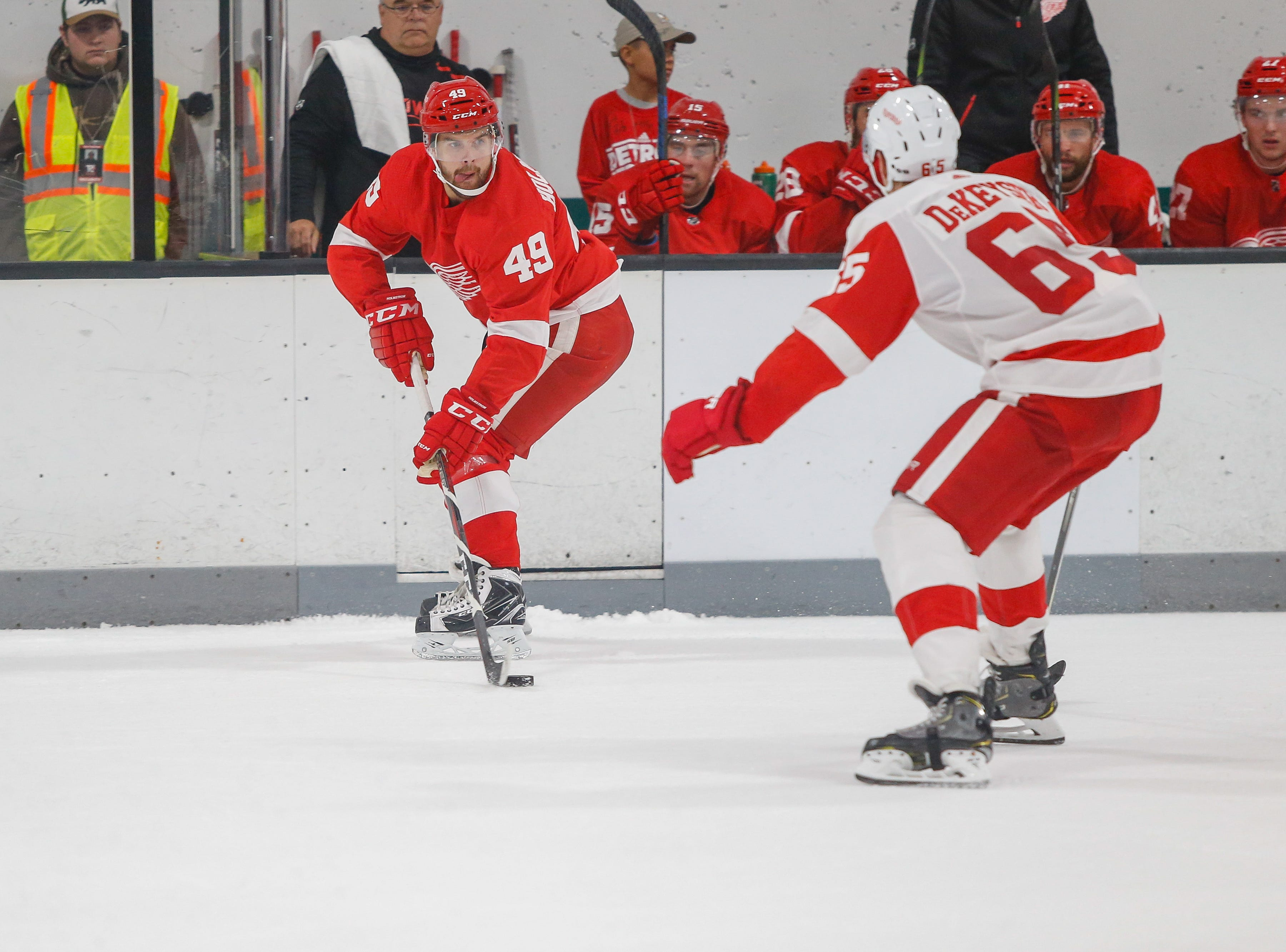 Axel Holmstrom looks for room to move the puck as Danny DeKeyser defends.
