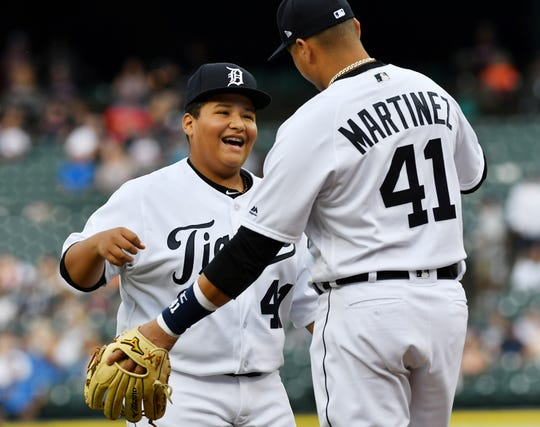 Victor Martinez hugs his son, Victor Jose, after Victor Jose throws out the ceremonial first pitch before the game against the Minnesota Twins on Aug. 11, 2018.