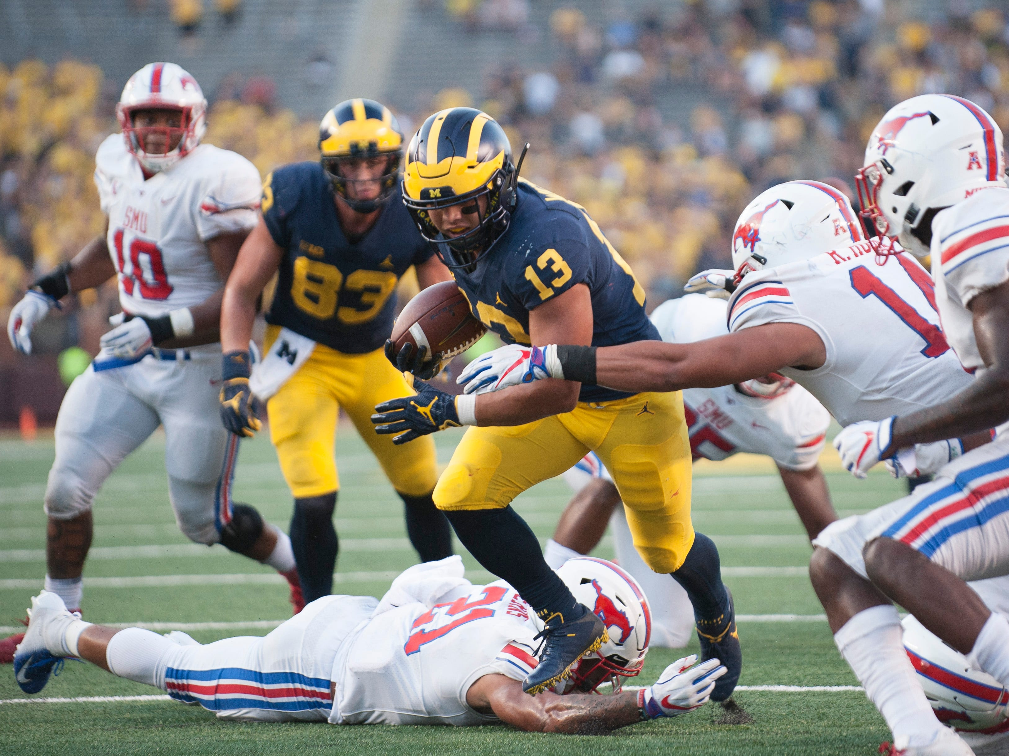 Michigan running back Tru Wilson scores on a nine-yard run in the fourth quarter. Wilson rushed for 53 yards on 11 carries.