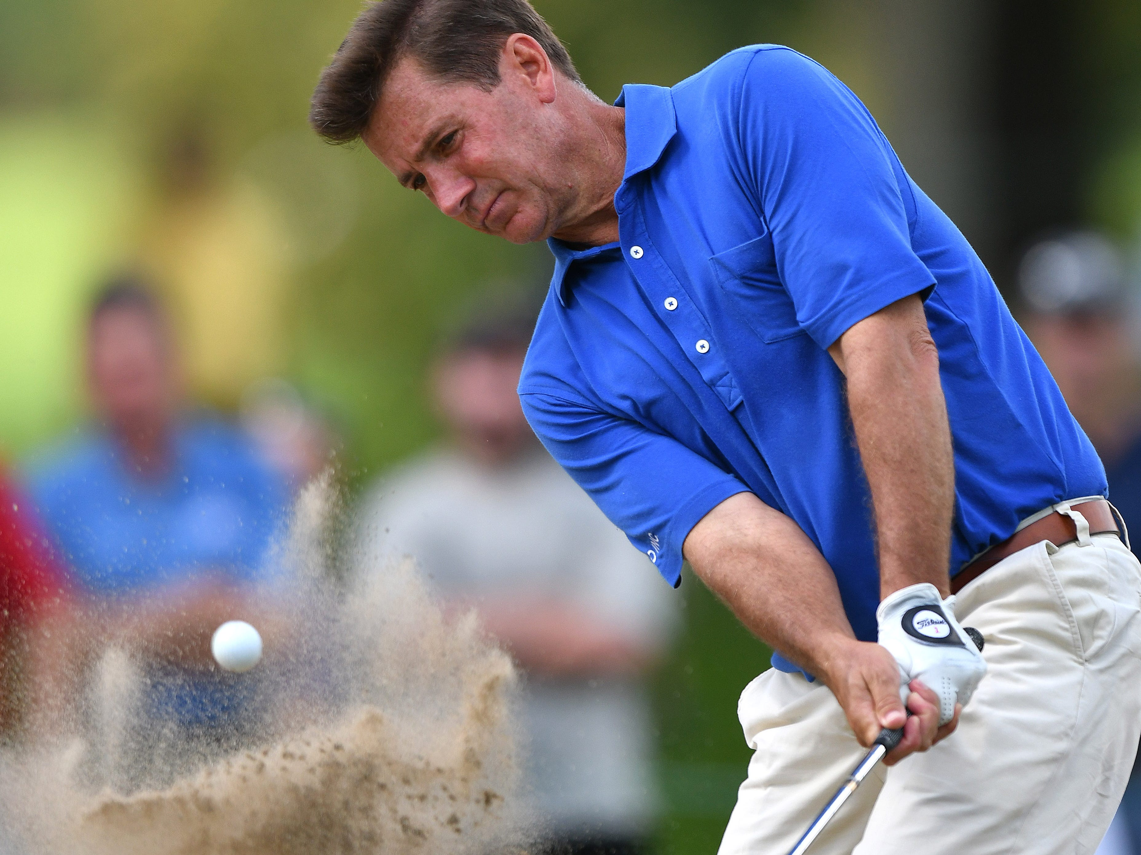Gibby Gilbert III hits out of a bunker on the first hole at the Ally Challenge.
