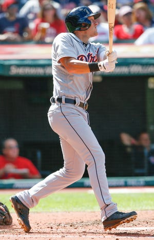 The Detroit Tigers' Jim Adduci hits a three-run home run off the Cleveland Indians' Shane Bieber during the fifth inning.