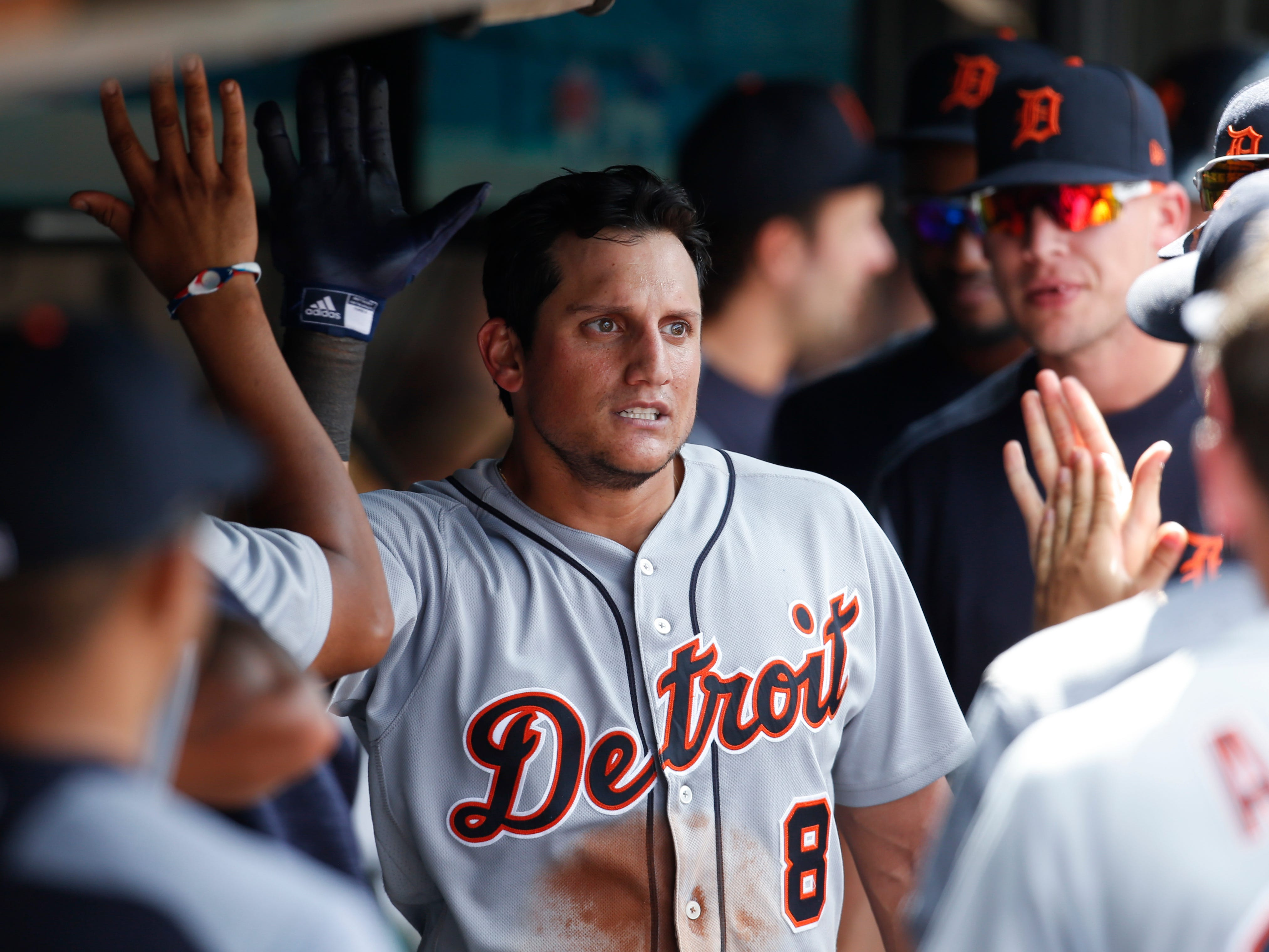 Detroit Tigers' Mikie Mahtook celebrates with teammates in the dugout after hitting a solo home run off Cleveland Indians' Andrew Miller during the eighth inning.