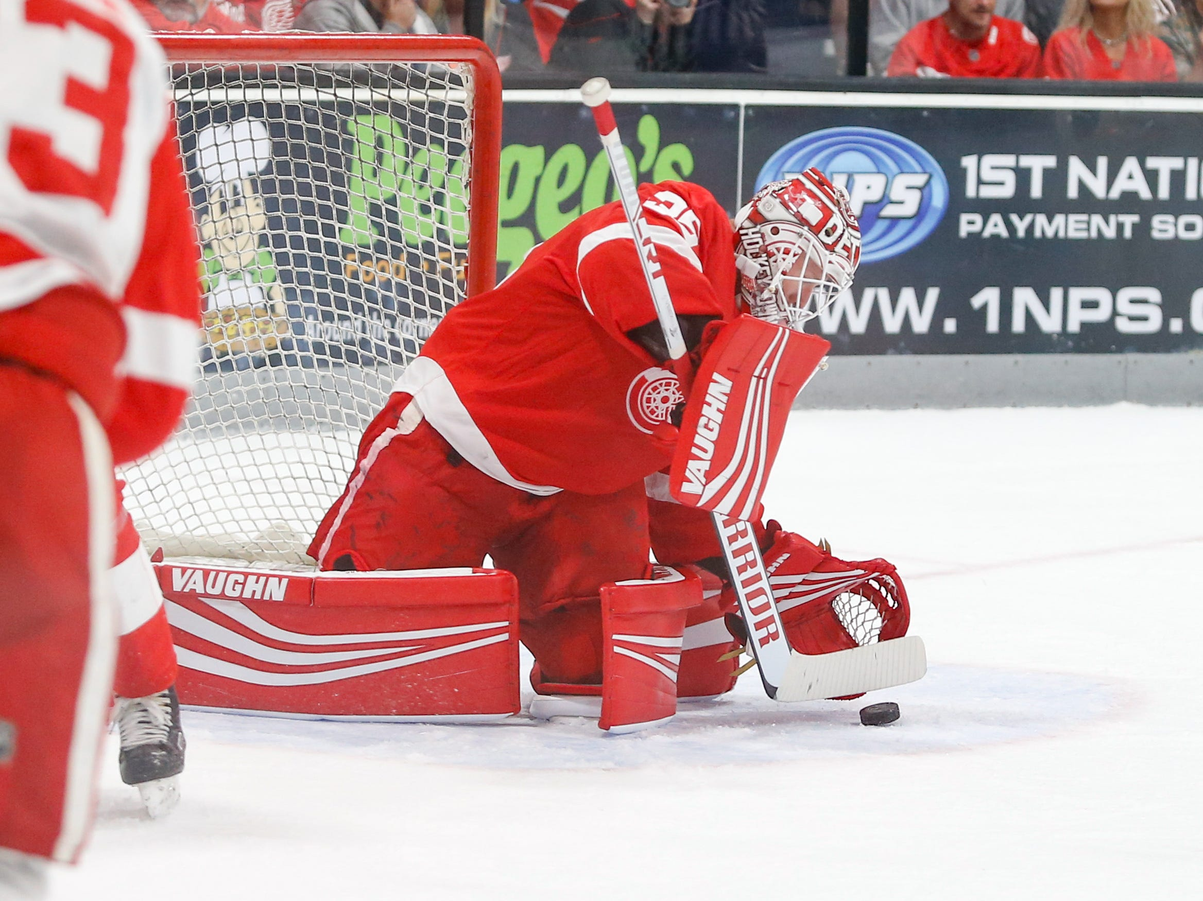 Goaltender Jimmy Howard covers a shot in the first period of the annual Detroit Red Wings Red-White game, a scrimmage that usually closes out training camp.