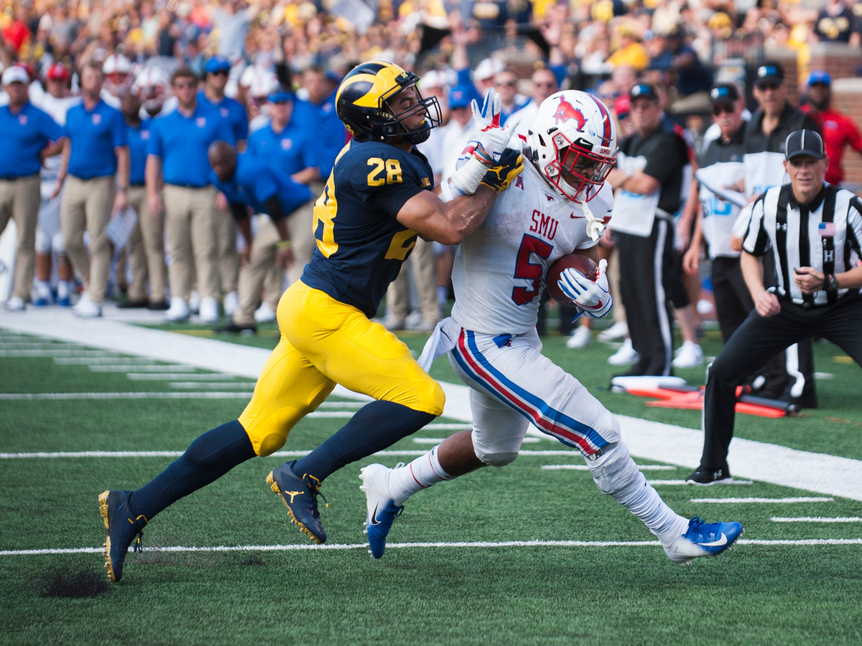Michigan defensive back Brandon Watson forces Southern Methodist running back Xavier Jones out of bounds near the goalline in the second half.  **** The Michigan Wolverines defeated the Southern Methodist University Mustangs 45-20 at Michigan Stadium in Ann Arbor on Saturday, September 15, 2018.  (John T. Greilick, The Detroit News)