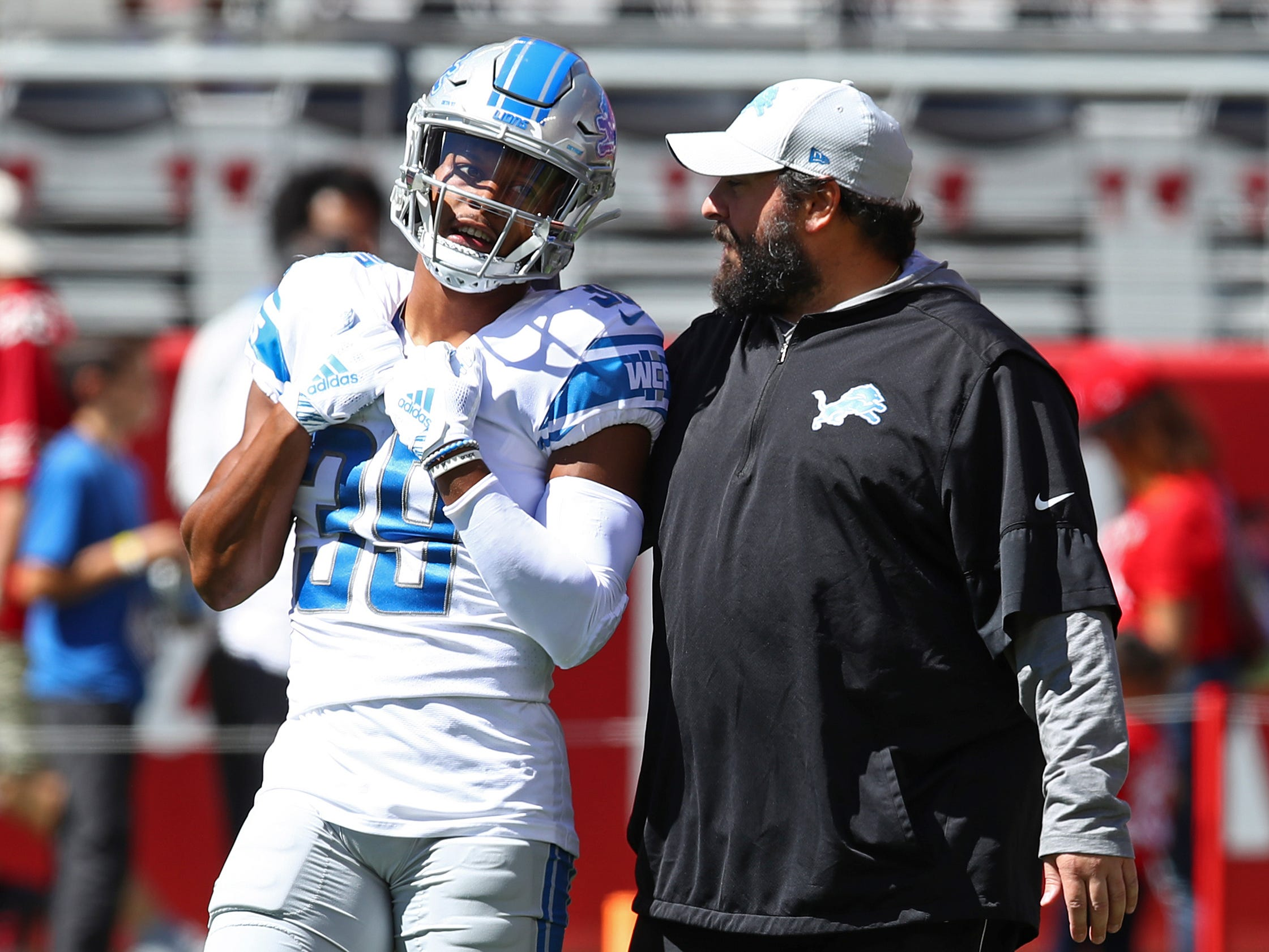 Detroit Lions cornerback Jamal Agnew (39) talks with Matt Patricia during warmups before an NFL football game against the San Francisco 49ers in Santa Clara, Calif., Sunday, Sept. 16, 2018.