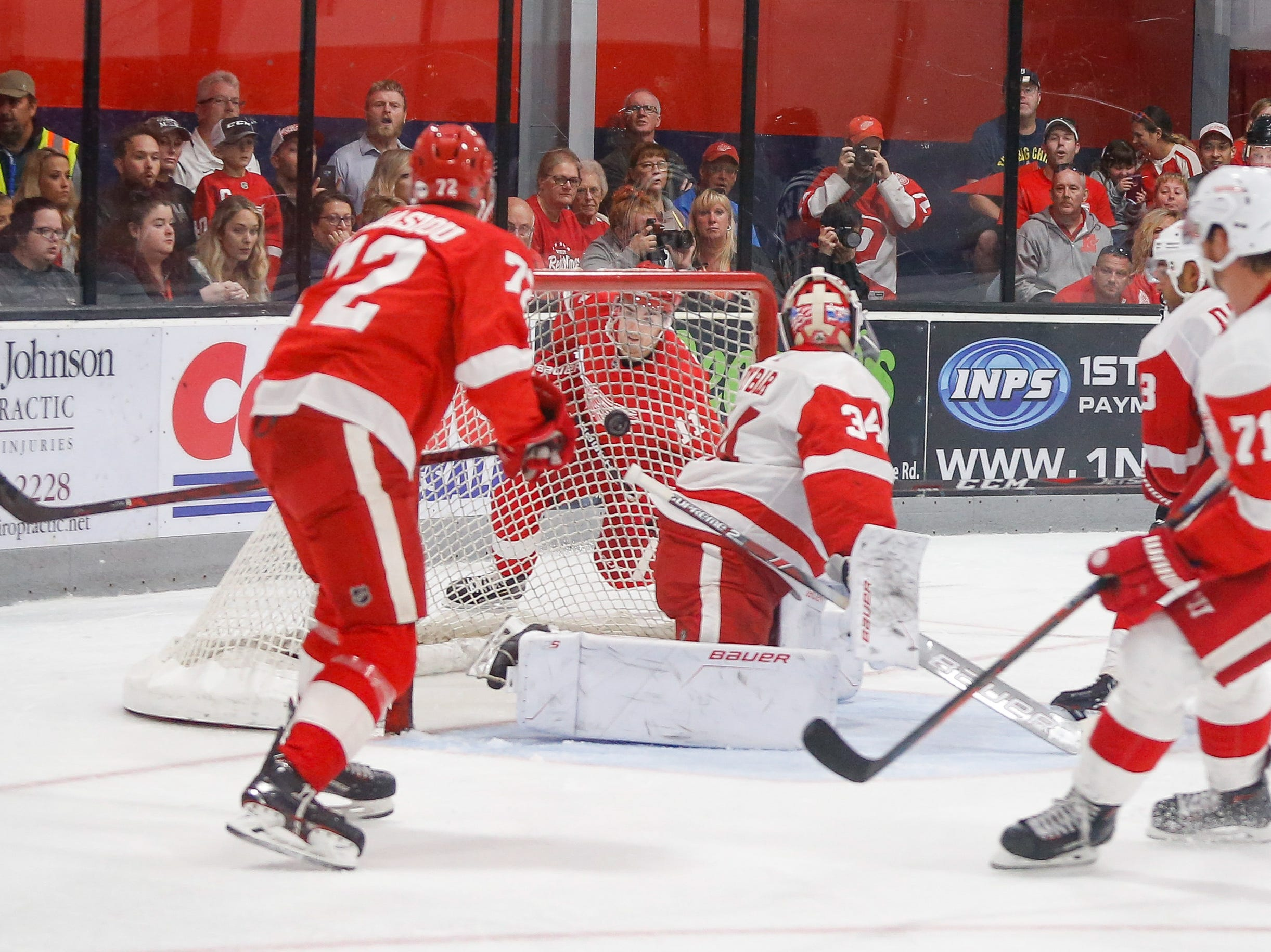 Filip Zadina, the Red Wings' top pick of the 2018 NHL draft, watches from behind the net as his second-period shot slips behind Patrik Rybar for a score, giving Team Red a 4-2 lead.
