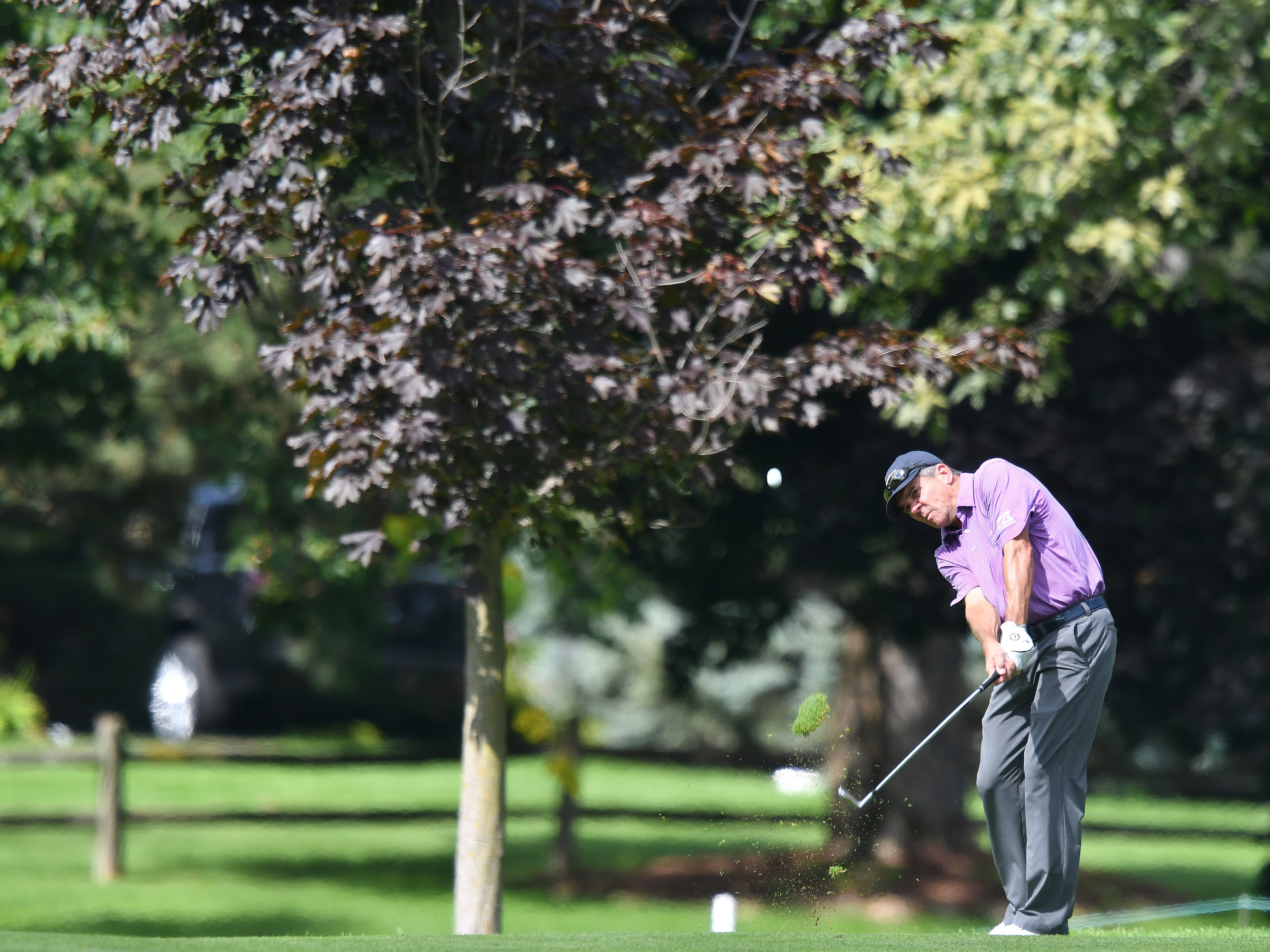 Scott Dunlap hits his approach shot on the first hole at the Ally Challenge.