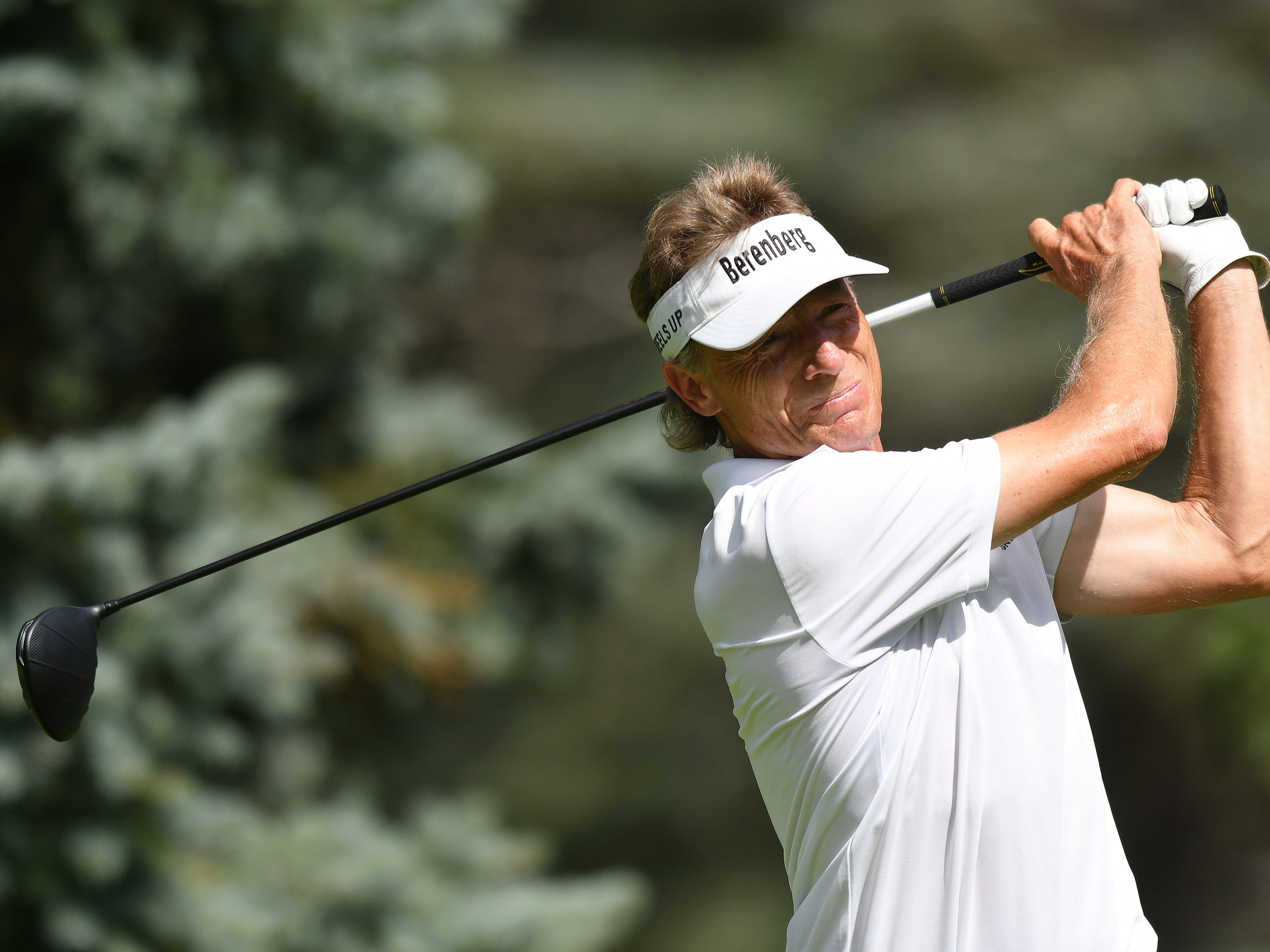 Bernard Langer watches his tee shot on the first hole at the Ally Challenge.