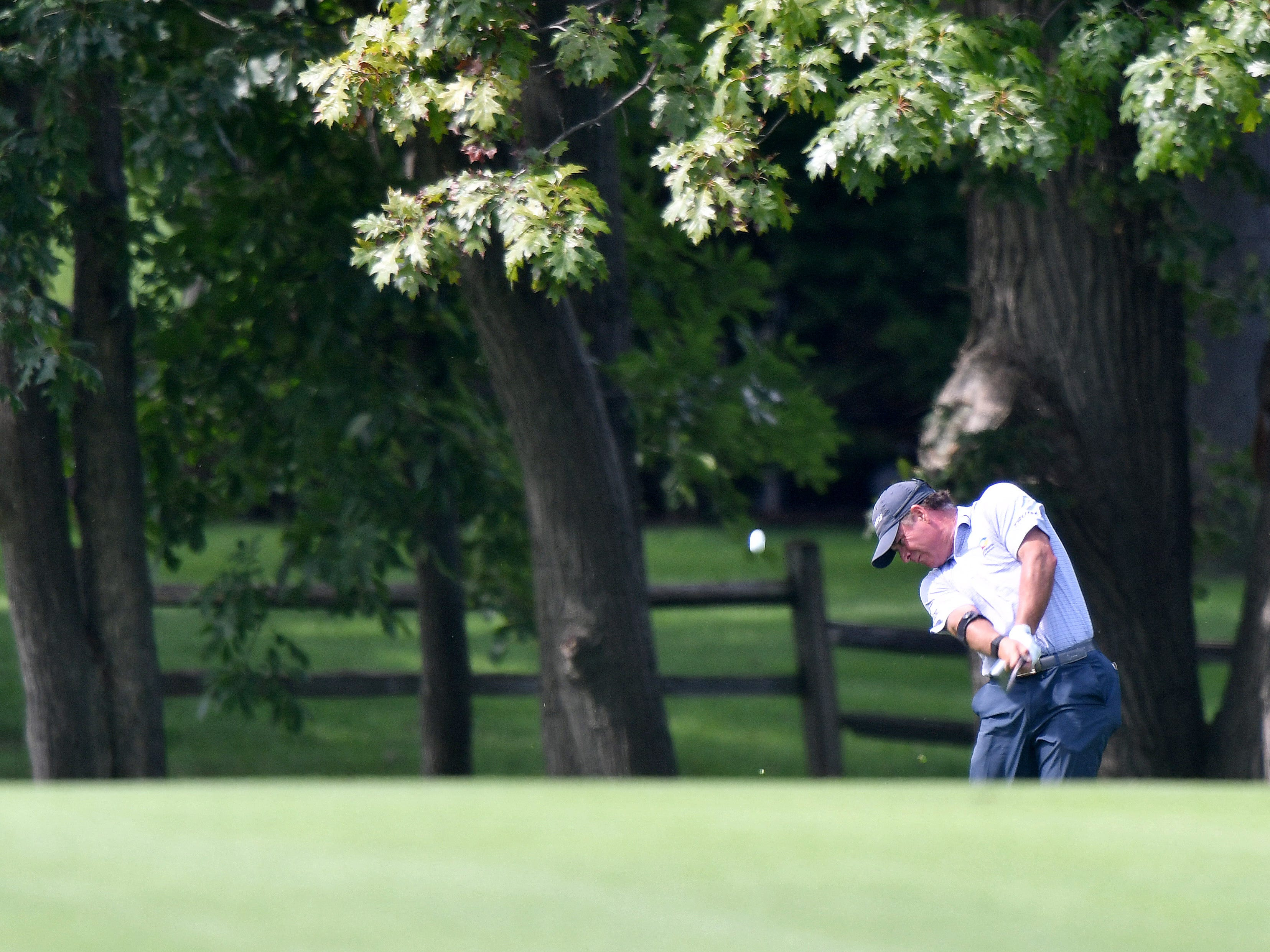 Scott McCarron hits a sceinic shot on the first hole.