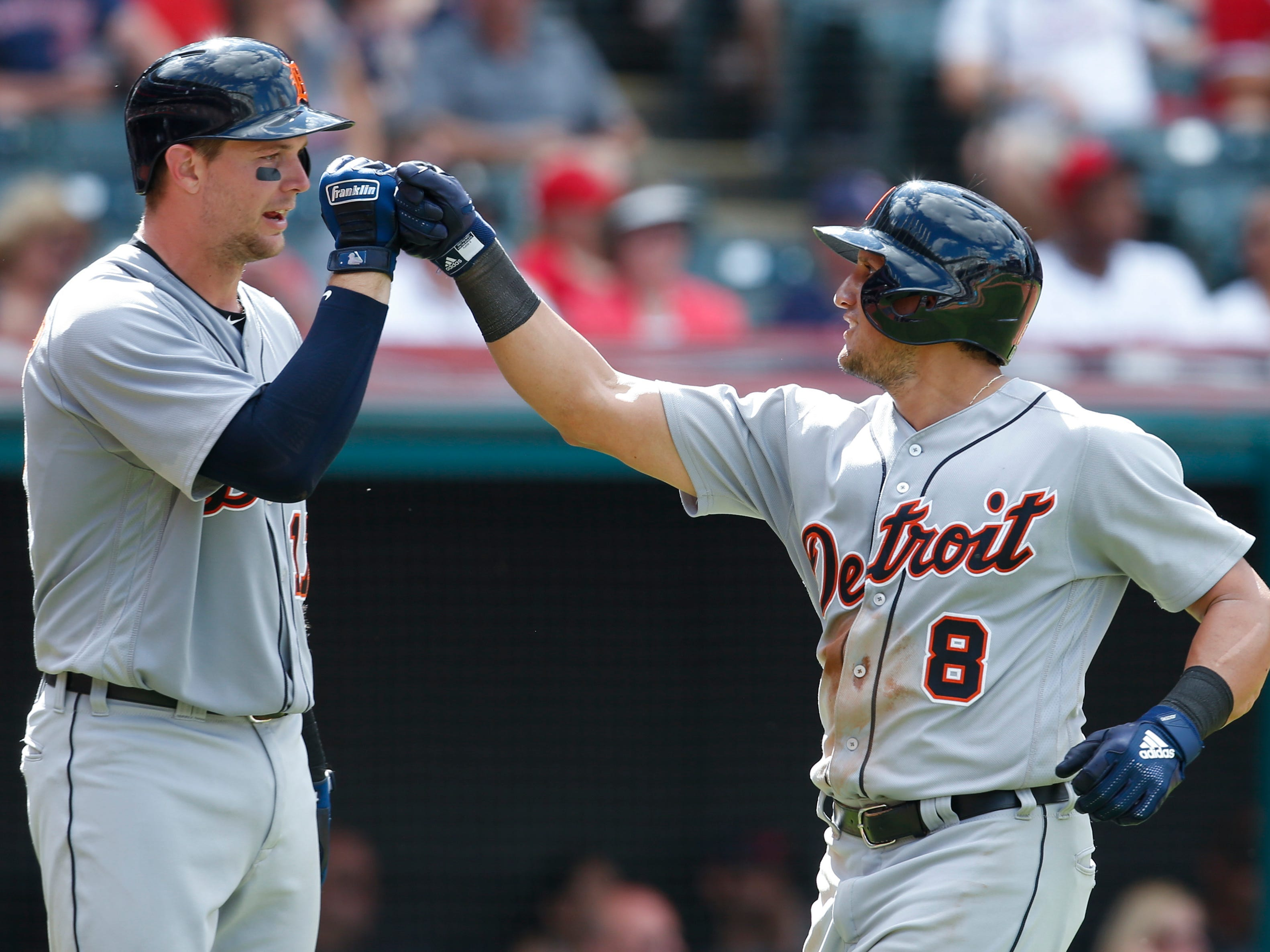 Detroit Tigers' Mikie Mahtook (8) celebrates with Grayson Greiner after hitting a solo home run off Cleveland Indians' Andrew Miller during the eighth inning.