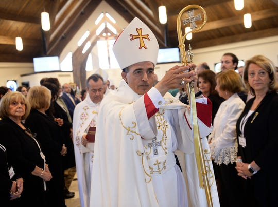 A. Elias Zaidan, bBishop of the Eparchy of Our Lady of Lebanon of Los Angeles, leads a dedication of the new church during the service on Sunday, Sept. 16, 2018.