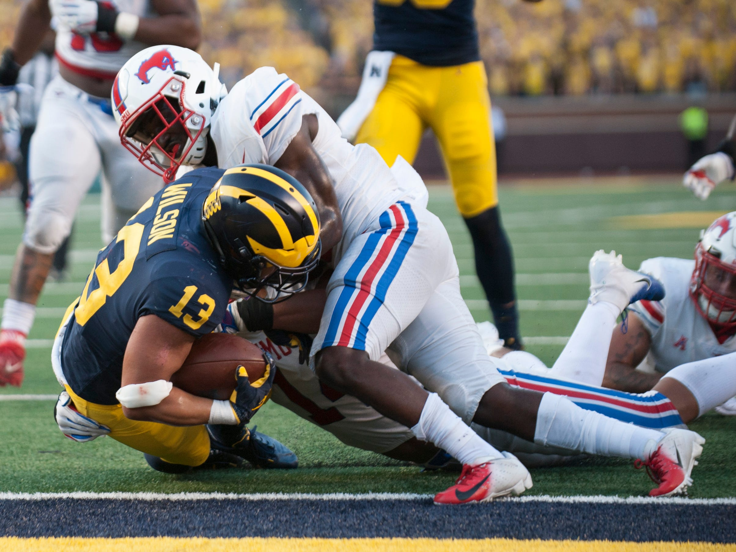 Michigan running back Tru Wilson bulls his way into the endzone on this nine-yard run in the fourth quarter. Wilson rushed for 53 yards on 11 carries and one touchdown.