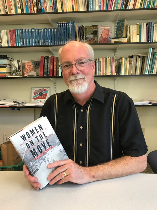 Author Roger Gilles with his book, Women on the Move.