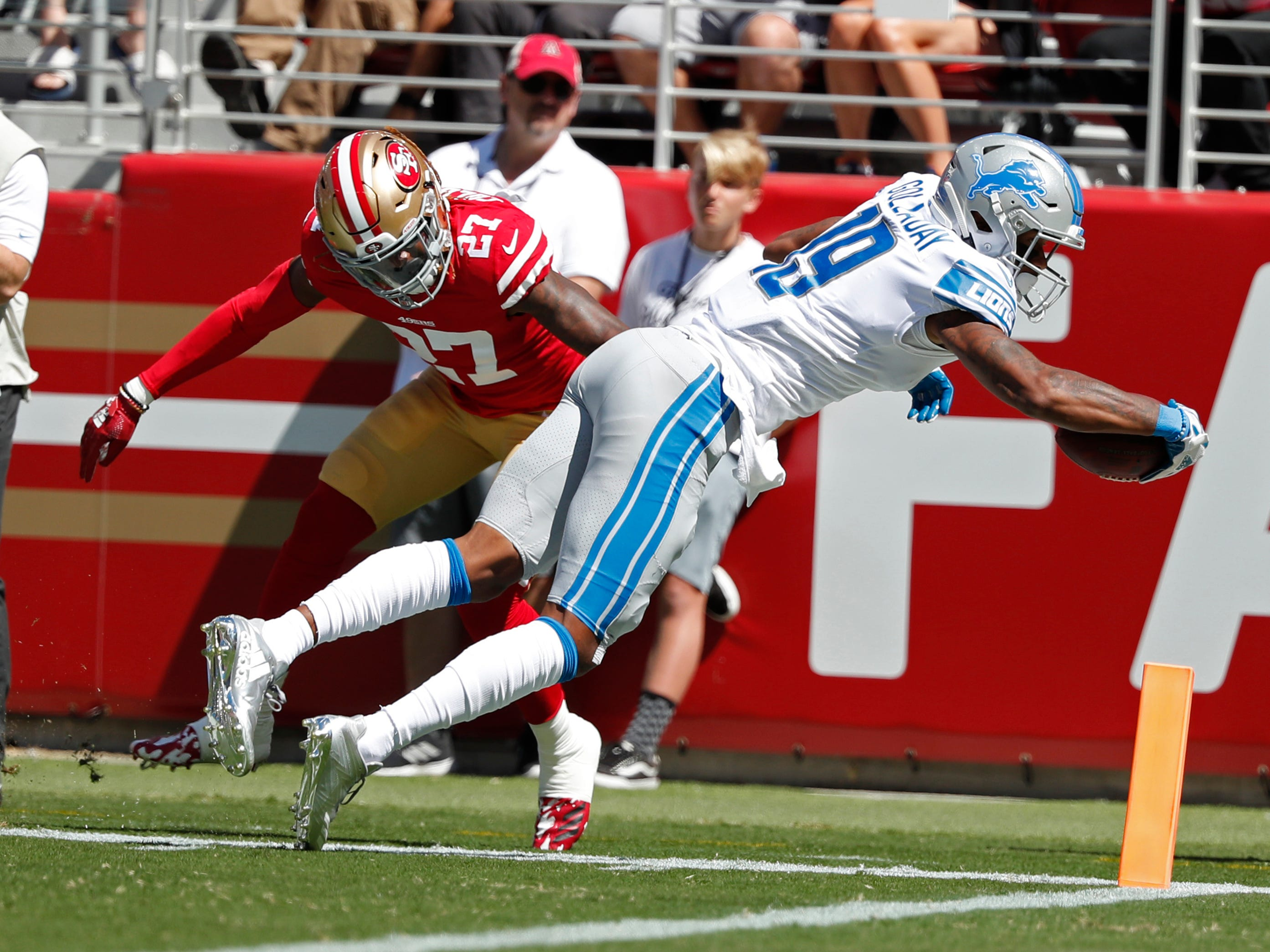 Detroit Lions wide receiver Kenny Golladay scores a touchdown as San Francisco 49ers defensive back Adrian Colbert (27) looks on during the first half.