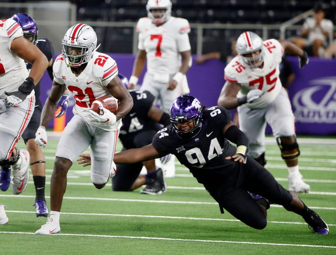 Ohio State wide receiver Parris Campbell (21) runs for a touchdown as TCU defensive tackle Corey Bethley (94) fails on a tackle attempt during the second half on Saturday.