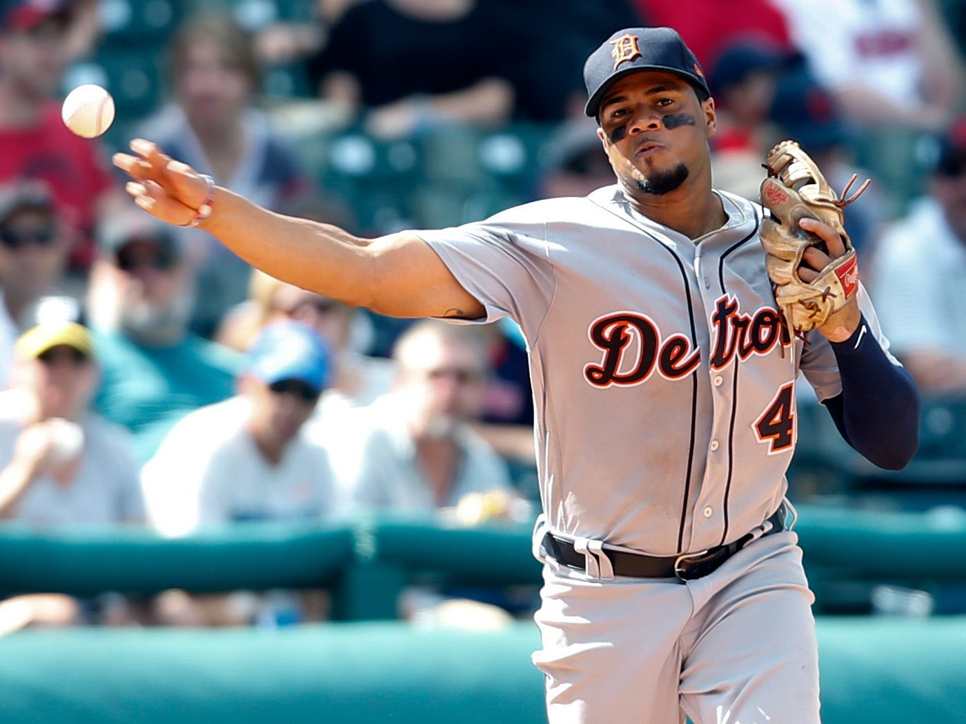 Detroit Tigers' Jeimer Candelario throws out Cleveland Indians' Adam Rosales at first base during the seventh inning.