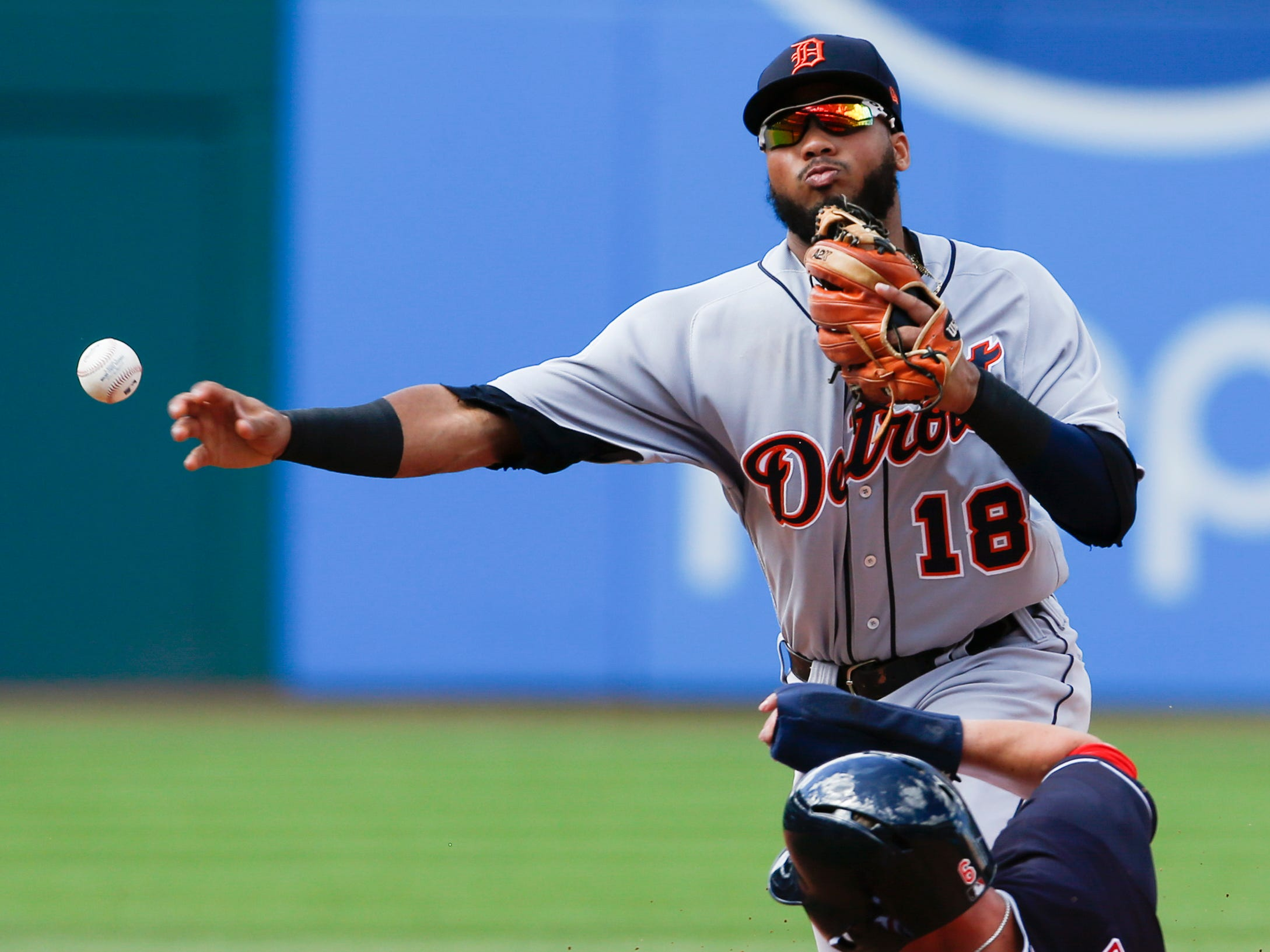 Detroit Tigers' Dawel Lugo forces out Cleveland Indians' Brandon Guyer at second base and throws out Eric Haase at first base to complete the double play during the sixth inning.