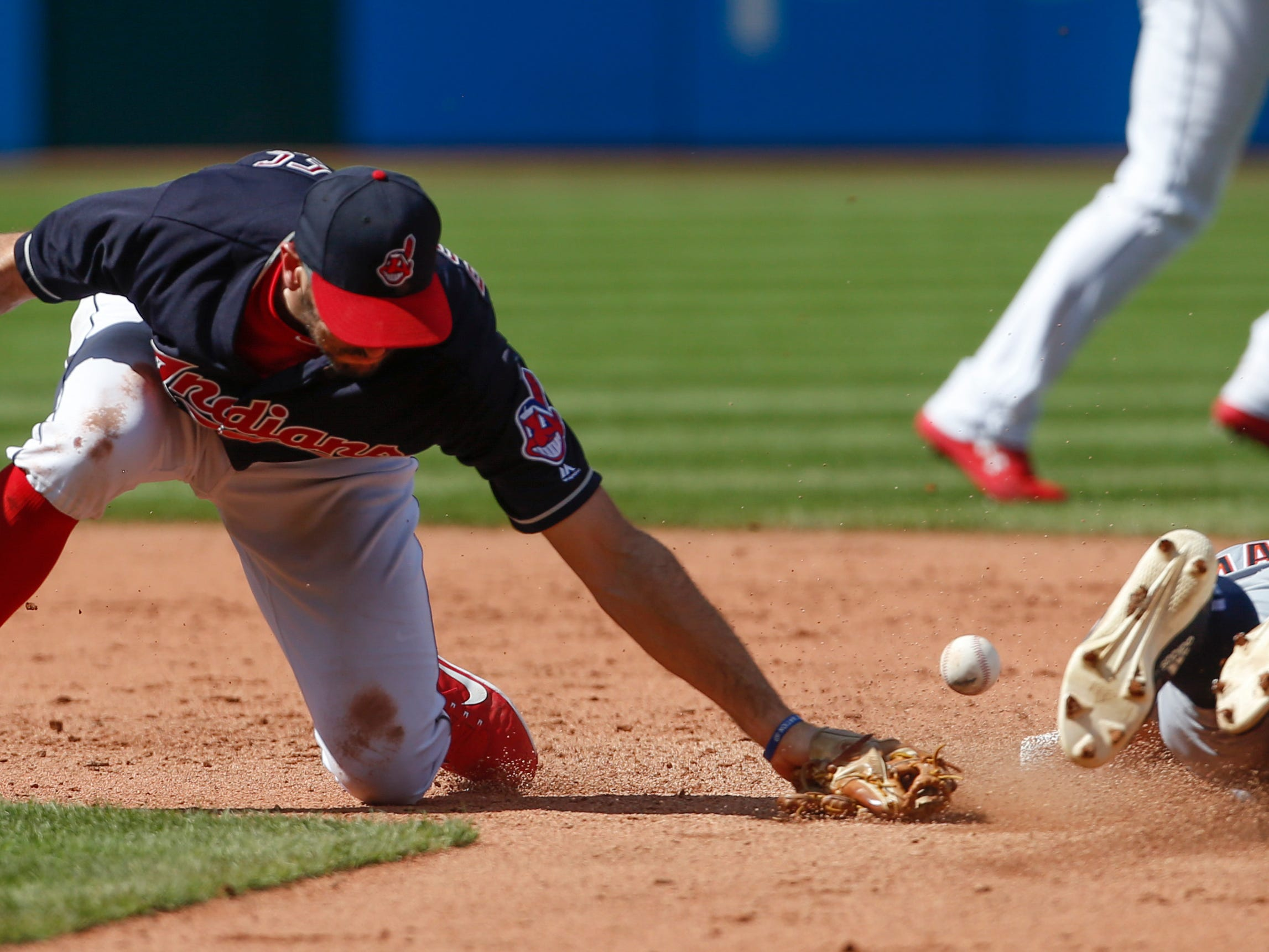 Detroit Tigers' Mikie Mahtook steals second base as the ball gets away from Cleveland Indians' Adam Rosales during the fifth inning.