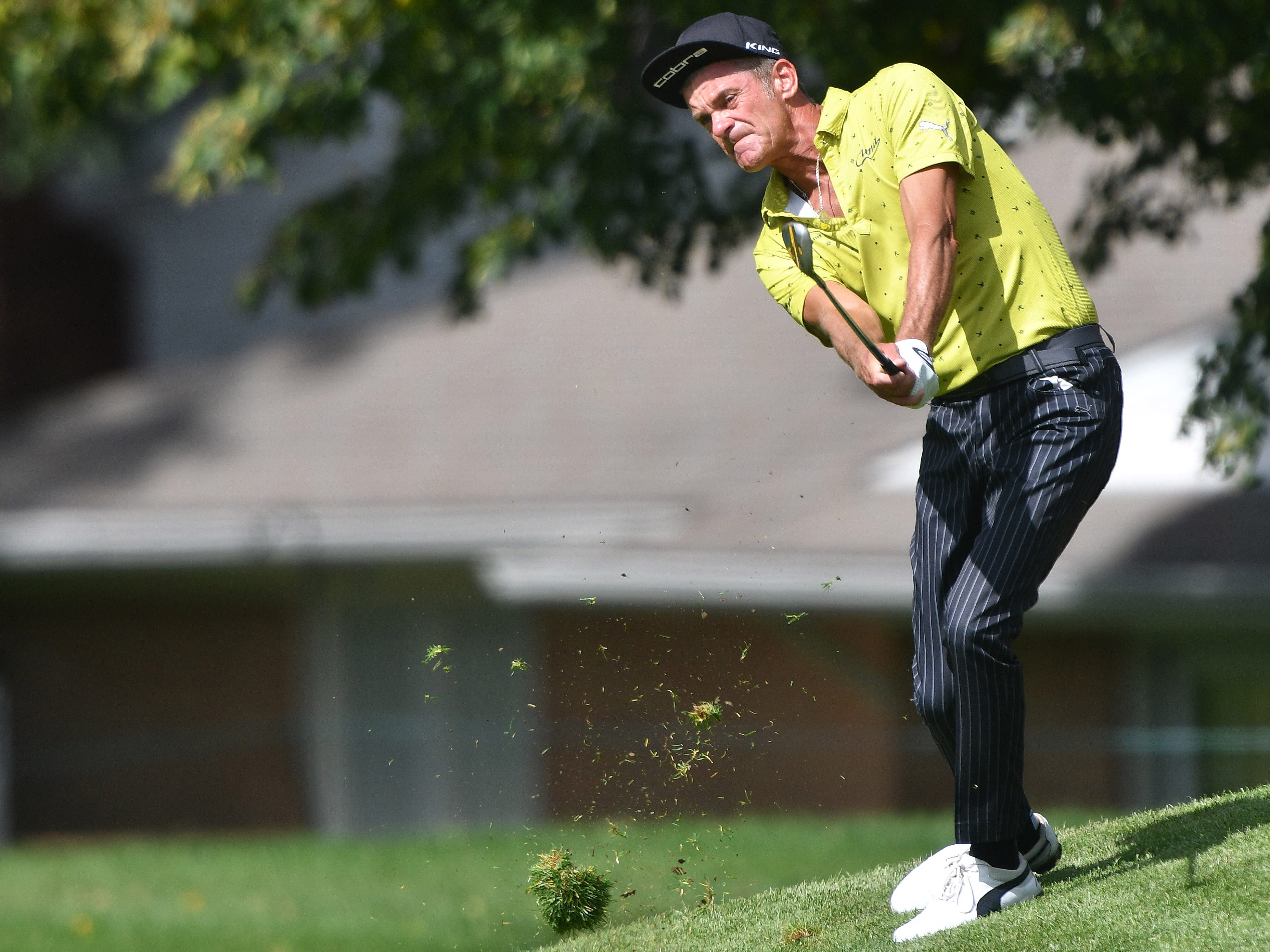 Jesper Parnevik shanks his approach shot on the first hole and puts it in the gallery across the fairway at the Ally Challenge.